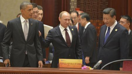 U.S. President Barack Obama, Russian President Vladimir Putin and Chinese President Xi Jinping attend a plenary session during the Asia Pacific Economic Cooperation (APEC) Summit in Beijing, November 11, 2014.