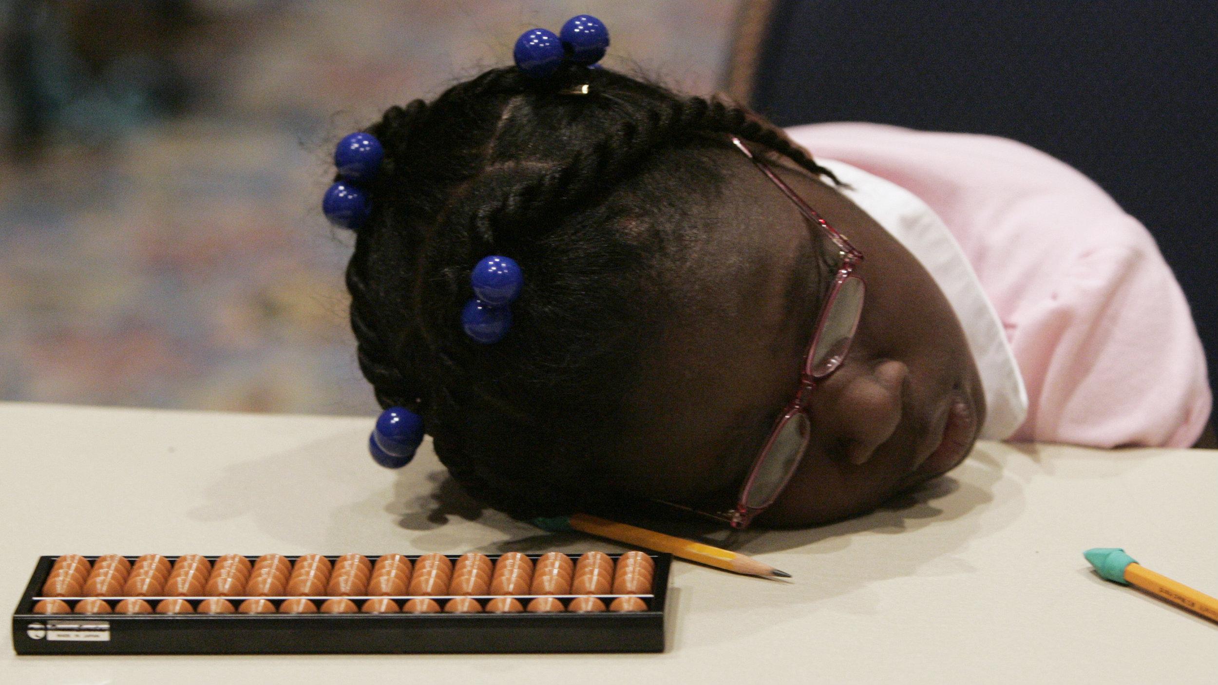 black girl sleeping on pencils