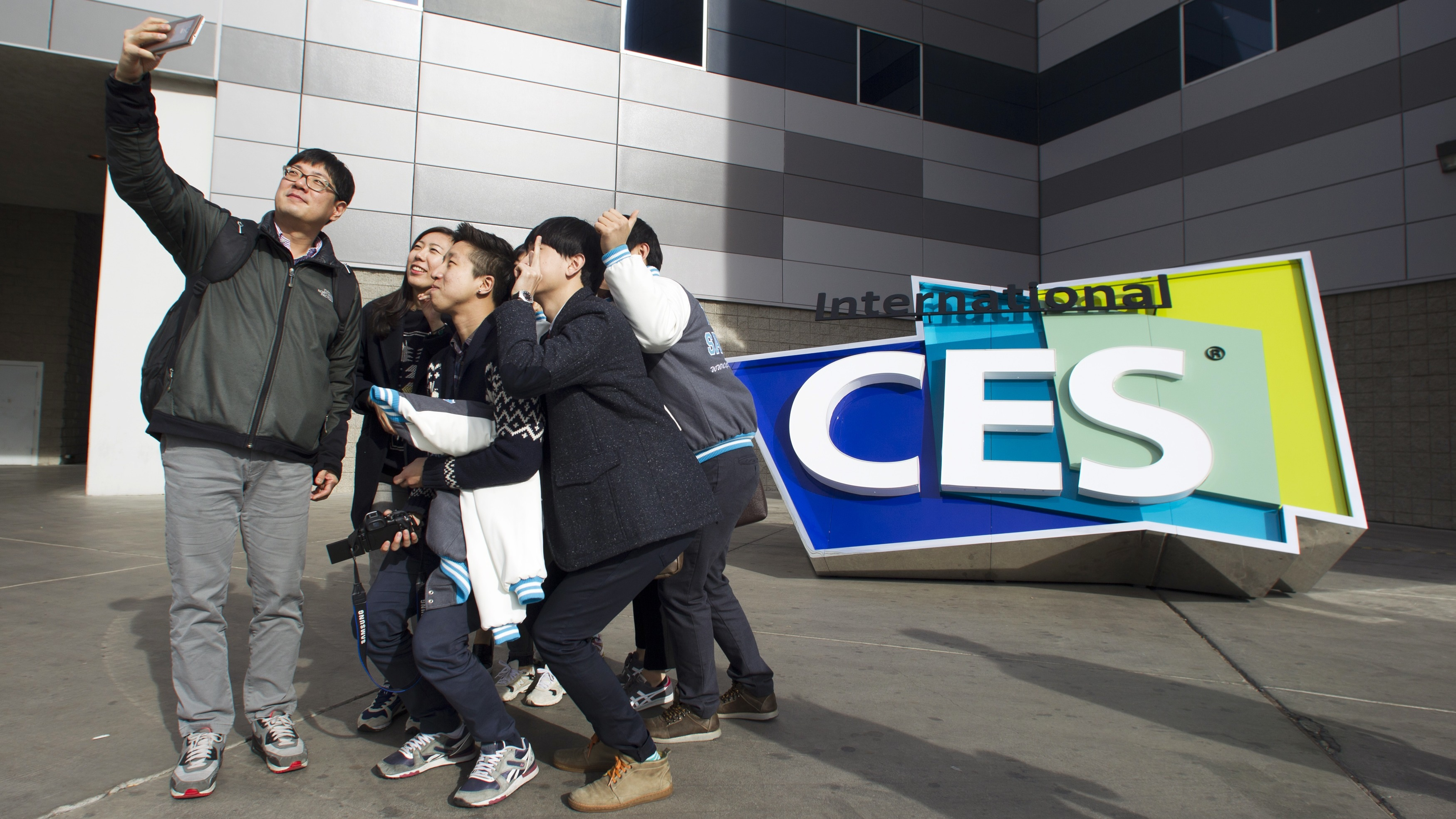 South Korean university students take a selfie in front of an International CES sign at the Las Vegas Convention Center in Las Vegas, Nevada January 4, 2015. The 2015 International Consumer Electronics Show (CES) officially starts on January 6. An estimated 150,000 people and 3,500 exhibitors are expected to attend, according to organizers. REUTERS/Steve Marcus