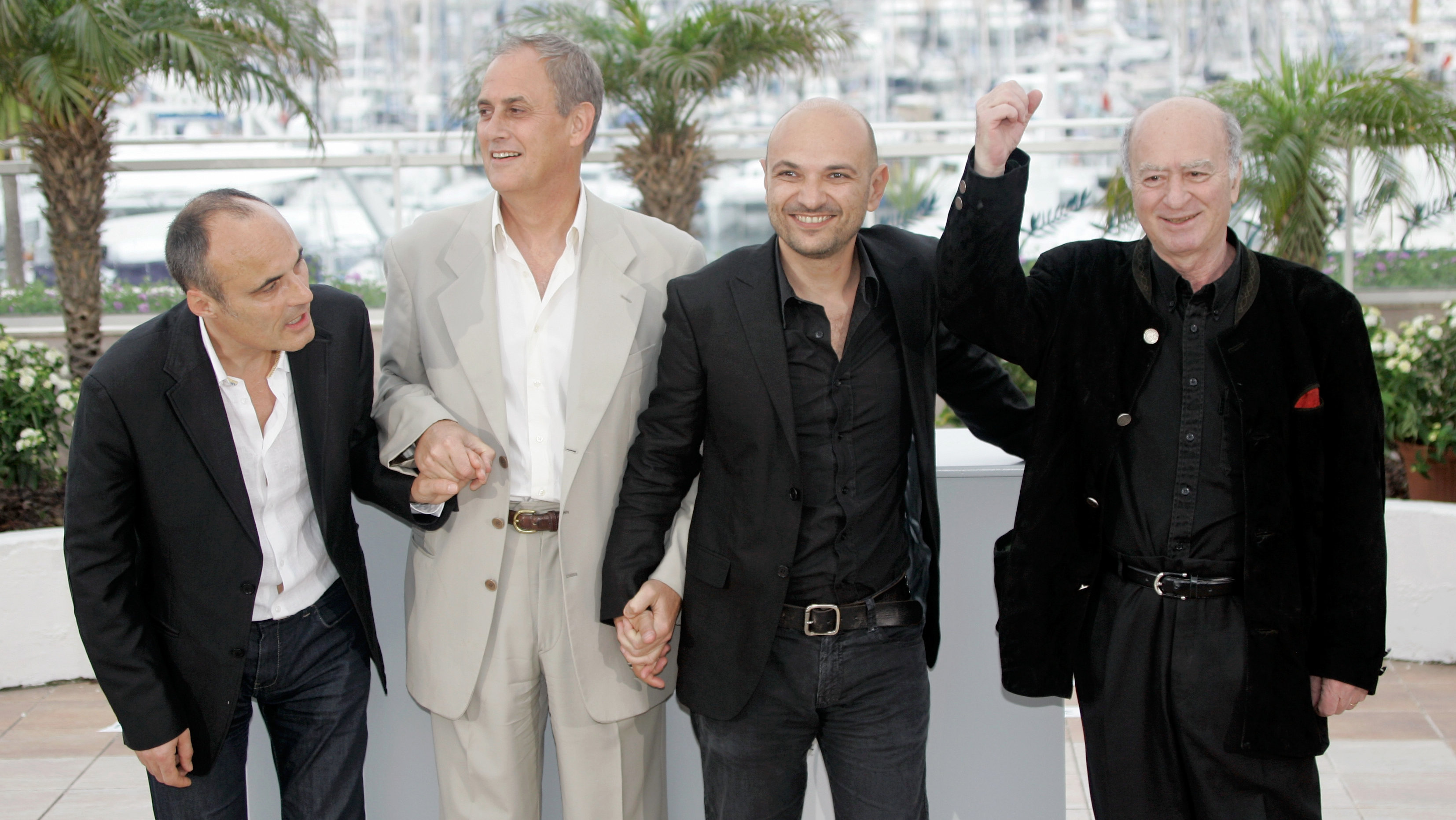 """From left, chief editor of French satyrical newspaper """"Charlie Hebdo"""", Philippe Val, French director Daniel Leconte, Charlie Hebdo's lawyer, Richard Malka and French cartoonist Georges Wolinski pose at the photo call for the documentary film """"C'est Dur d'Etre Aime Par Des Cons,"""" during the 61st International film festival in Cannes, southern France, on Friday, May 16, 2008. ("""