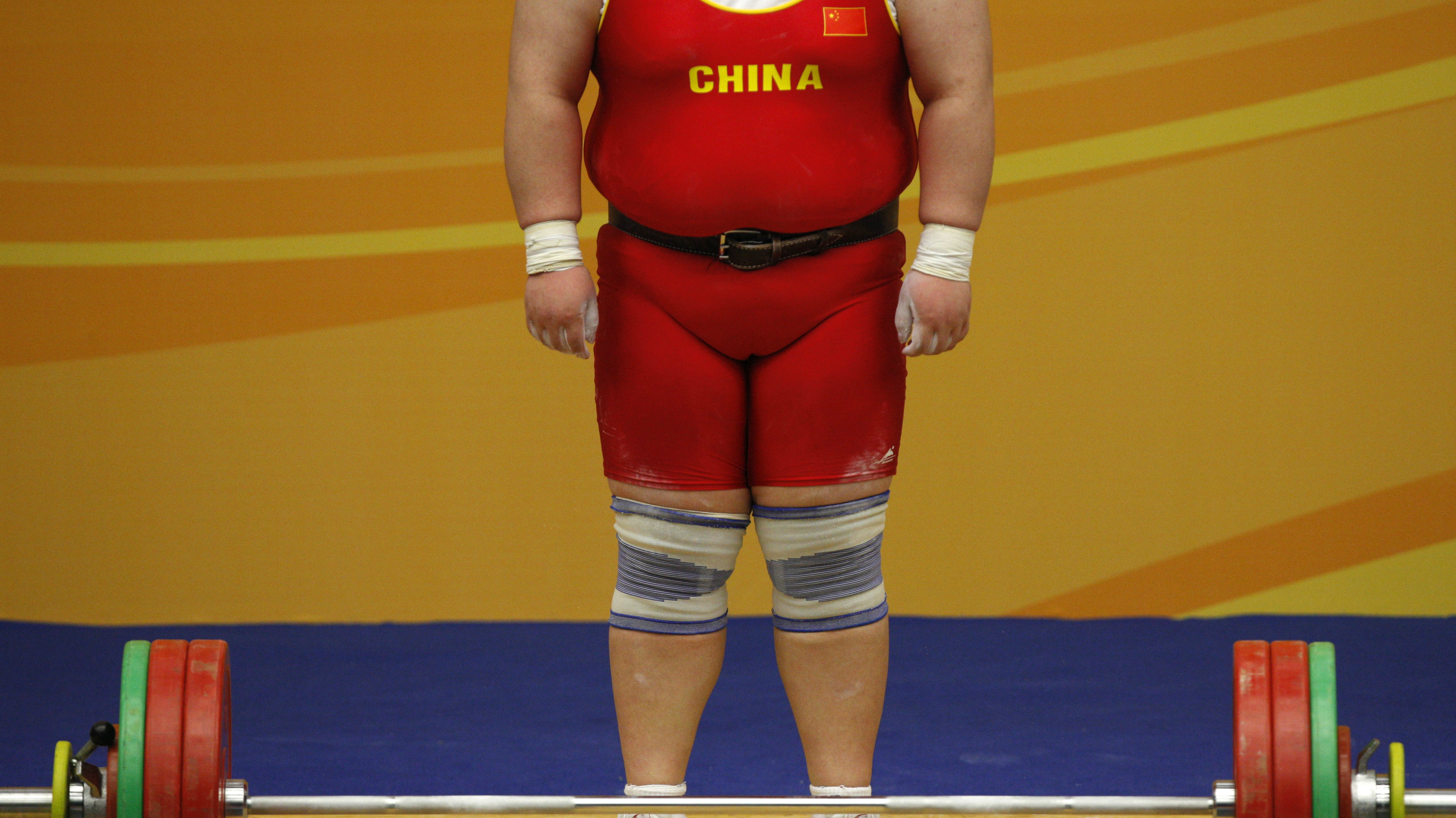 DATE IMPORTED:December 11, 2009China's Qi Xihui waits to compete during the clean and jerk session of the women's +75kg competition at the East Asian Games in Hong Kong December 11, 2009. REUTERS/Tyrone Siu