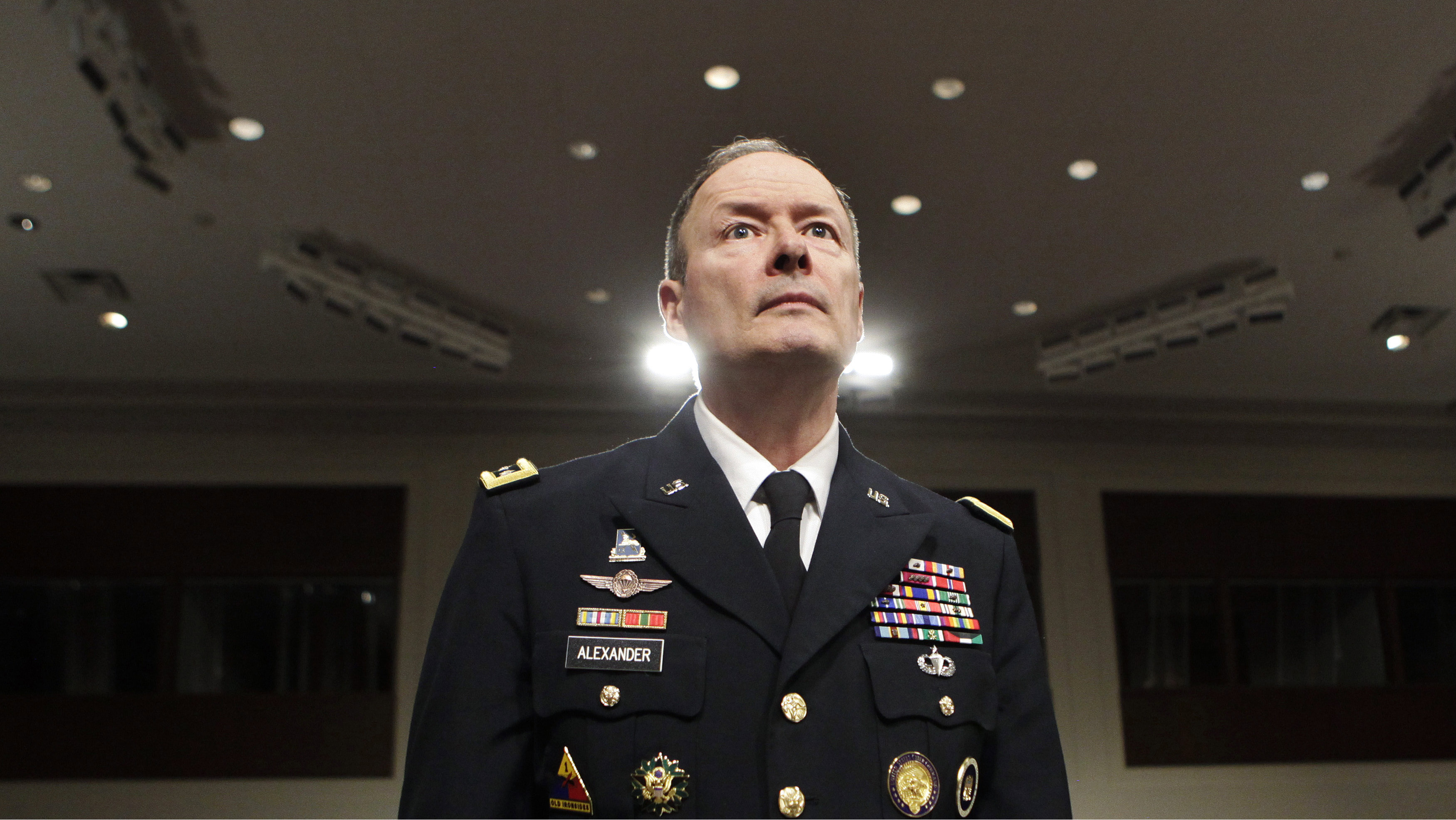 General Keith Alexander, commander of the U.S. Cyber Command, director of the National Security Agency (NSA) and chief of the Central Security Service (CSS), arrives at the Senate Appropriations Committee hearing on Cybersecurity: Preparing for and Responding to the Enduring Threat, on Capitol Hill in Washington June 12, 2013.
