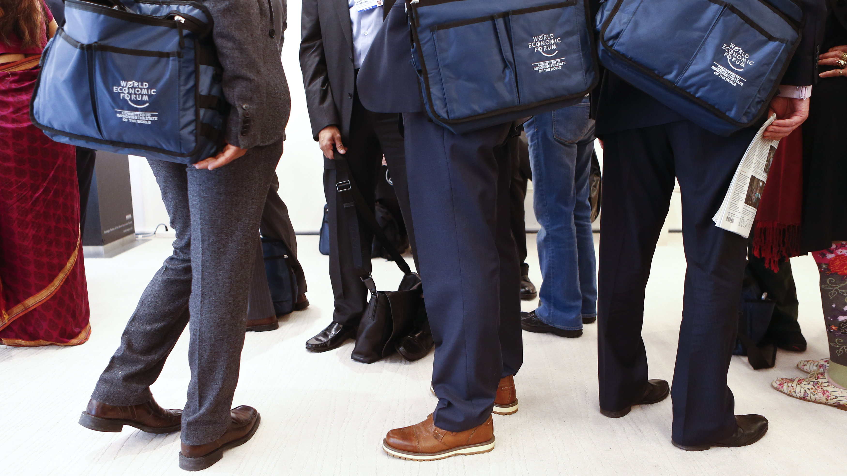 davos members with matching bags