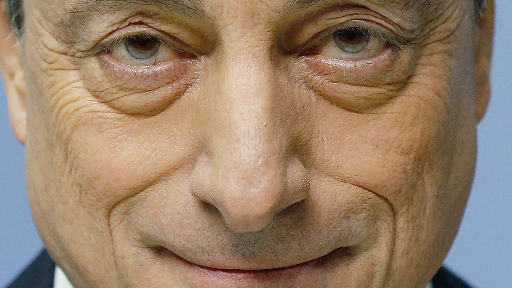 President of European Central Bank Mario Draghi waits for the beginning of a news conference in Frankfurt, Germany, Thursday, Jan. 22, 2015, following a meeting of the ECB governing council. (AP Photo/Michael Probst)