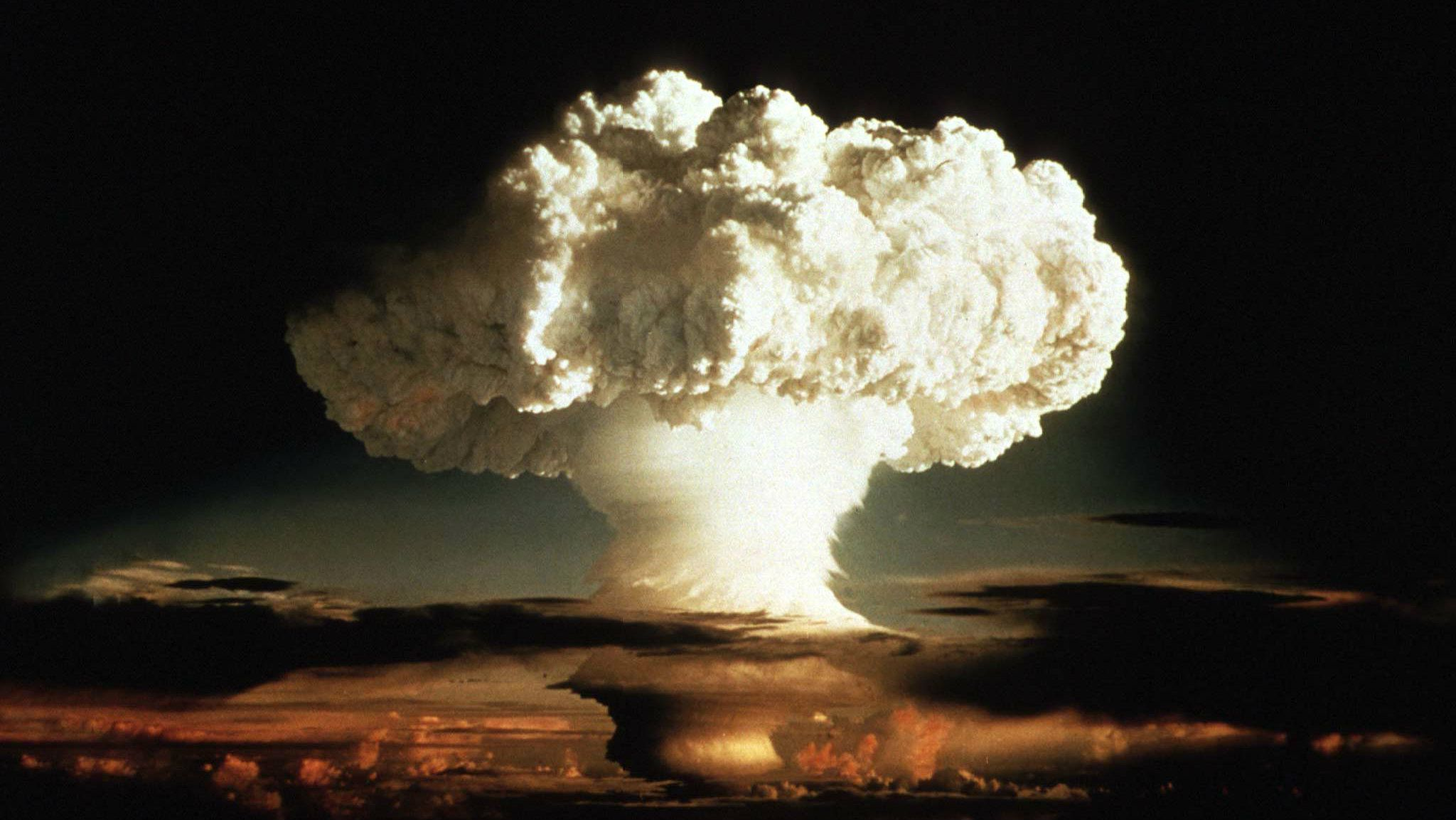 """- 1952 FILE PHOTO - The mushroom cloud of the first test of a hydrogen bomb, """"Ivy Mike"""", as photographed on Enewetak, an atoll in the Pacific Ocean, in 1952, by a member of the United States Air Force's Lookout Mountain 1352d Photographic Squadron. The top secret film studio, then located in Hollywood, California, produced thousands of classified films for the Department of Defence and the Atomic Energy Commission beginning in 1947. A 50th anniversary tribute to these """"Atomic Cinematographers"""" and their work is planned for October 22 in Hollywood. BEST QUALITY AVAILABLE"""