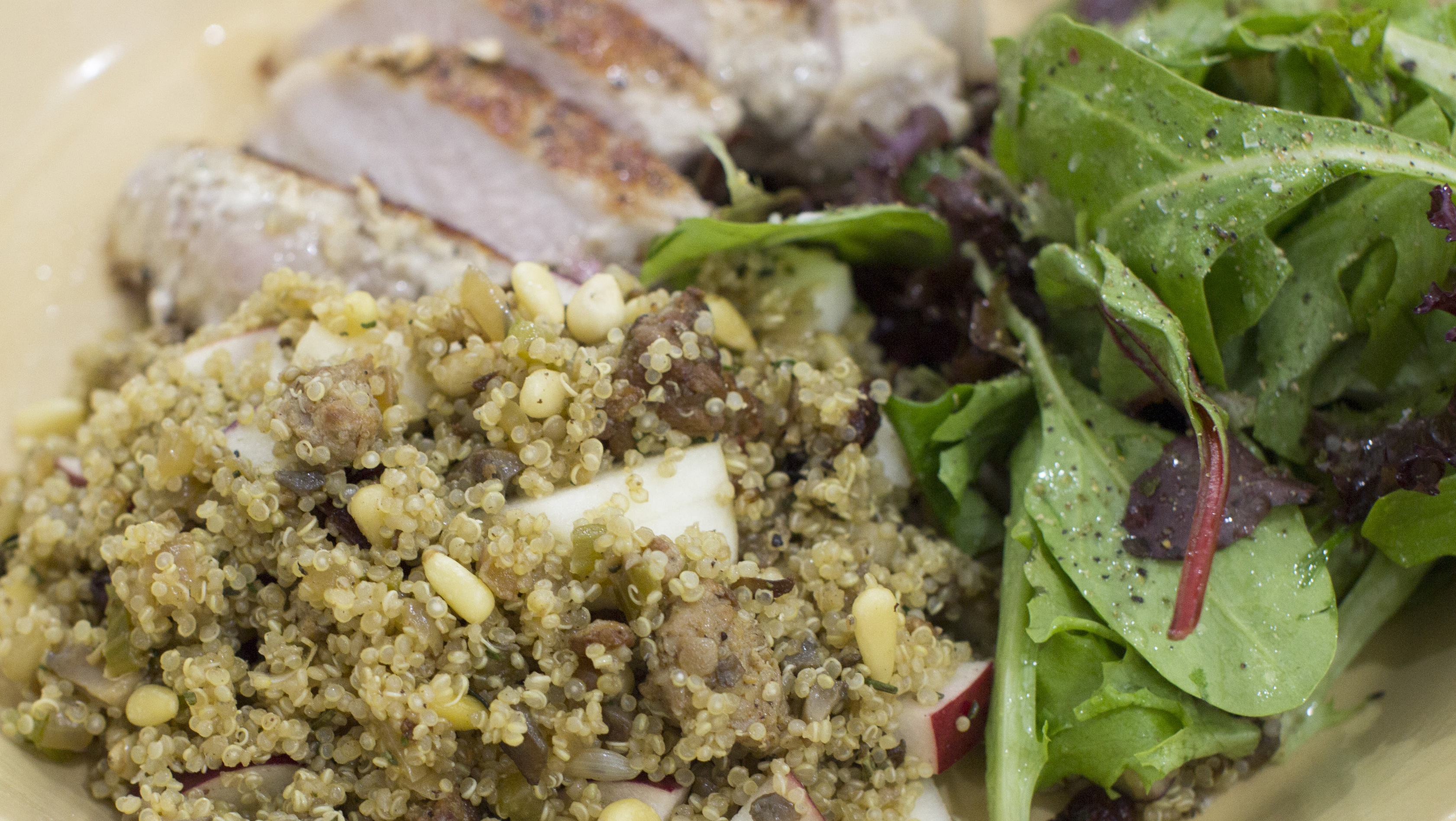 This Dec. 1, 2014, photo shows winter quinoa dressing with apples and dried cranberries in Concord, N.H. (AP Photo/Matthew Mead)