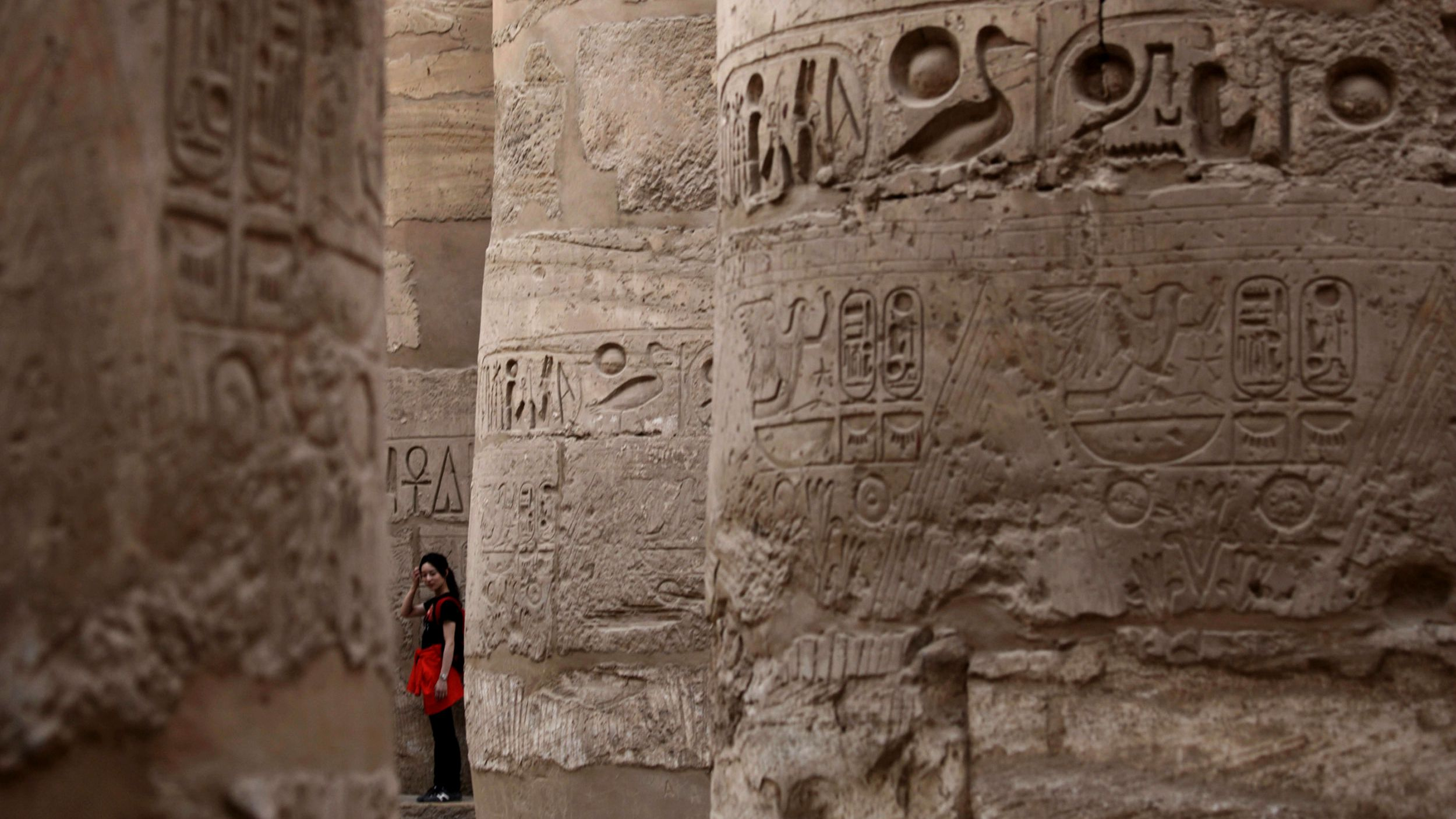 A tourist stands in Karnak Temple in Luxor, southern Egypt, November 9, 2009