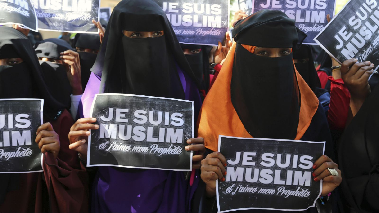 "University students hold placards during a demonstration against satirical French weekly Charlie Hebdo, which featured a cartoon of the Prophet Mohammad as the cover of its first edition since an attack by Islamist gunmen, in Somalia's capital Mogadishu, January 17, 2015. The text on the placards read, ""I am Muslim and I love my Prophet""."