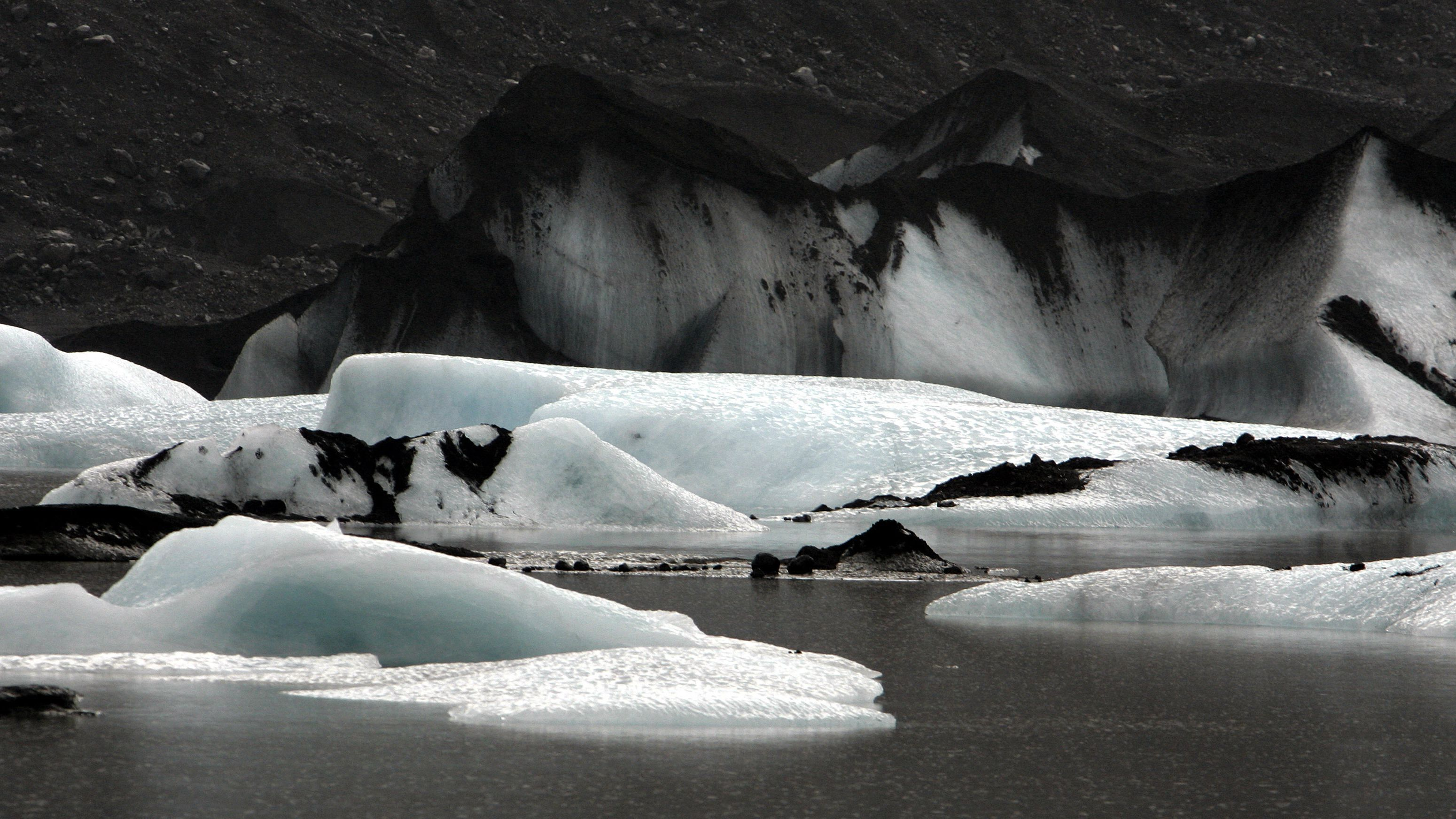 The tongue of a glacier melts into a glacial lagoon in the Porsmork nature reserve, Iceland, Thursday Feb. 23, 2006. (AP Photo/Kirsty Wigglesworth