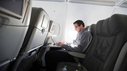 A man uses his laptop to test a new high speed inflight Internet service named Fli-Fi while on a special JetBlue media flight out of John F. Kennedy International Airport in New York
