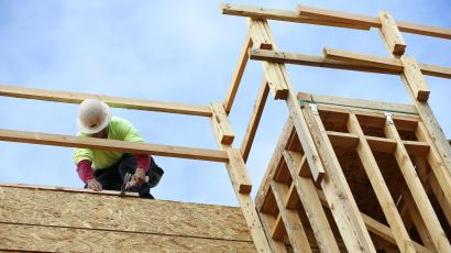 In this Jan. 12, 2015 photo, a builder works on a new apartment building under construction in Phoenix. The National Association of Home Builders releases housing market index for January on Tuesday, Jan. 20, 2015. (AP Photo/Ross D. Franklin)