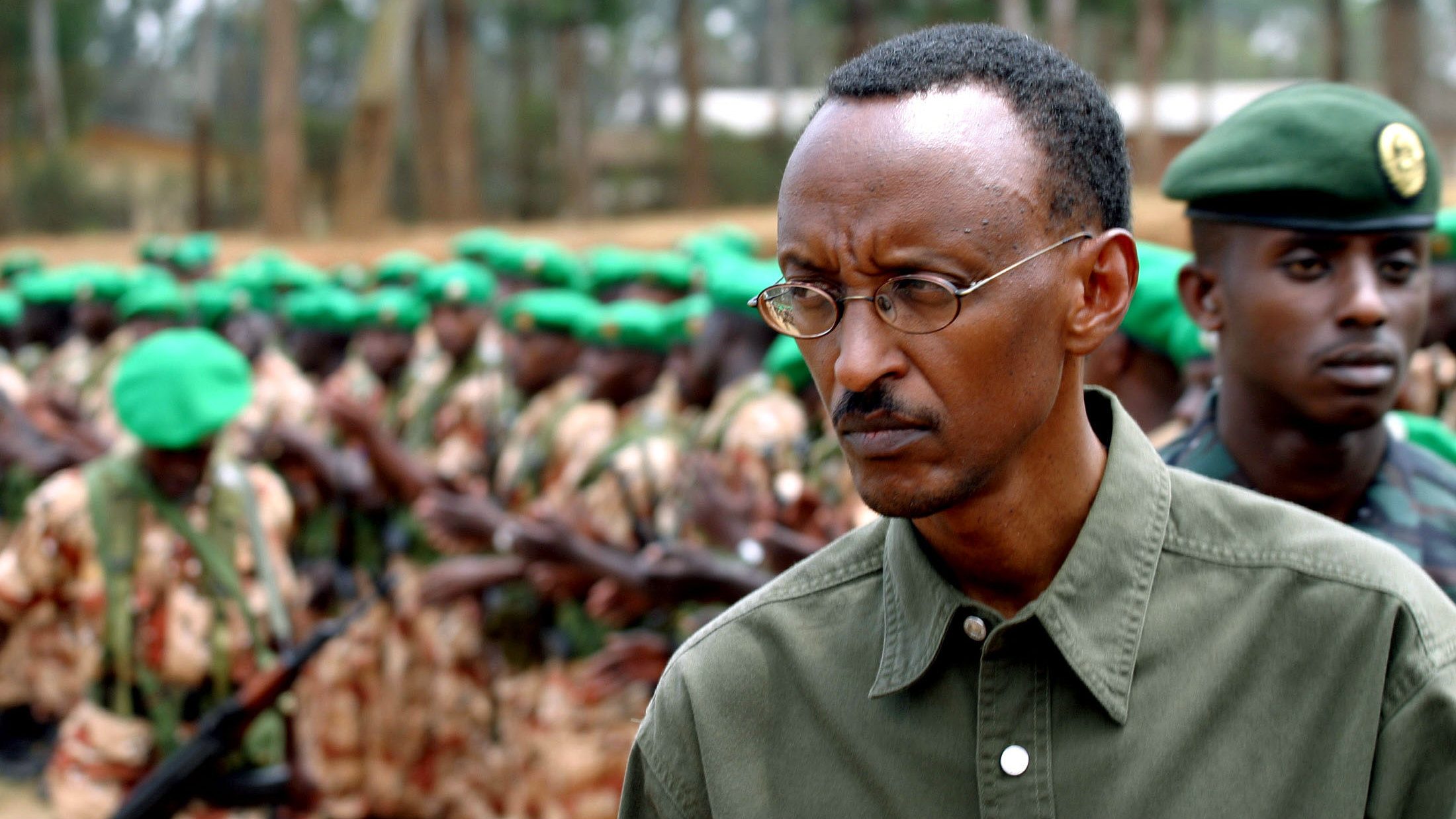 Rwandan President Paul Kagame inspects the 154 army troops during a ceremony in Kigali, August 14, 2004 before the soldiers deploy to Sudan as part of an African Union force to protect ceasefire observers in the country's troubled Darfur region.