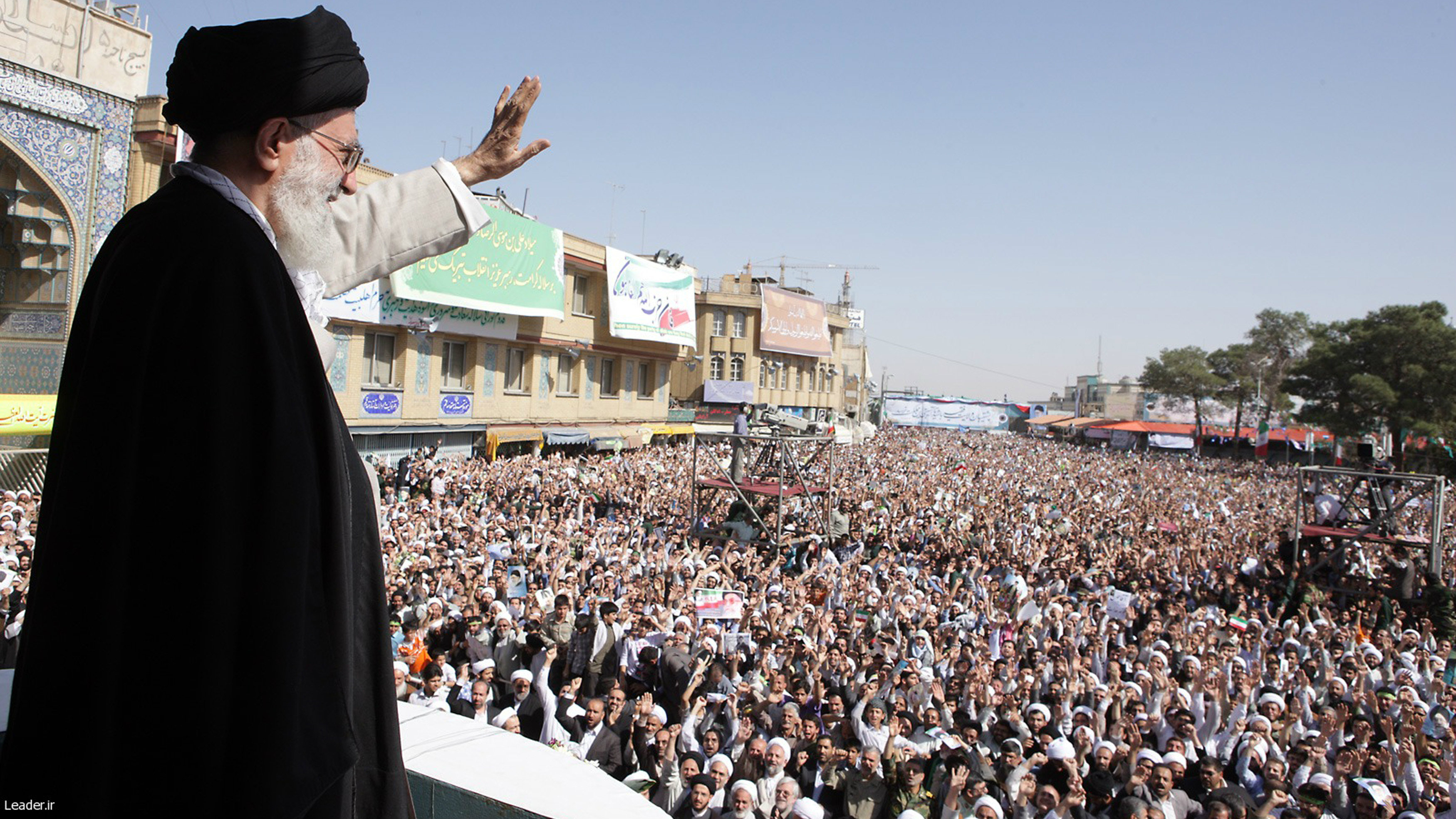 Iran's Supreme Leader Ayatollah Ali Khamenei waves to the crowd in the holy city of Qom, 120 km (75 miles) south of Tehran, October 19, 2010.