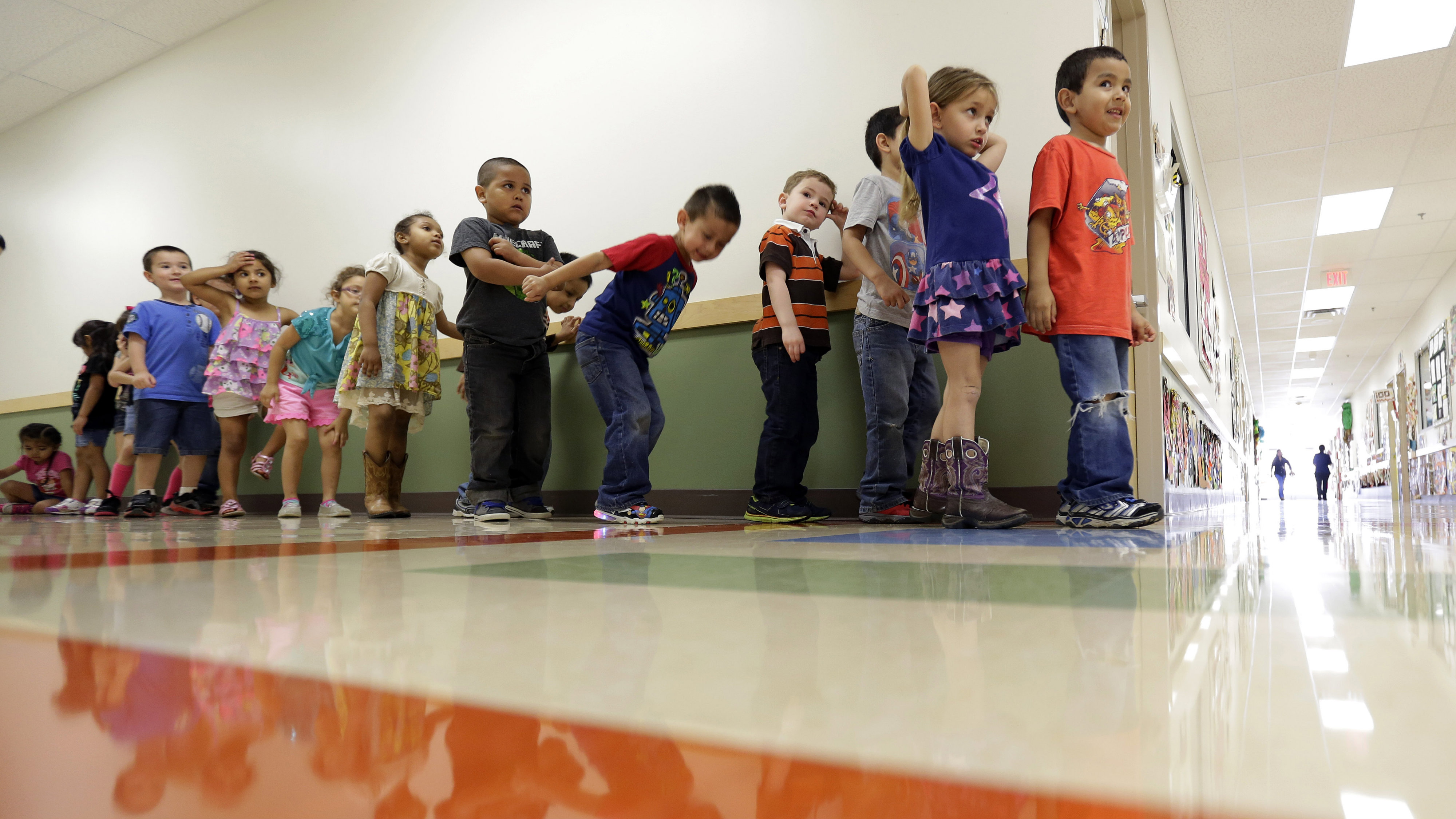 Pre-K students line up outside a classroom at the South Education Center, Wednesday, April 2, 2014, in San Antonio.