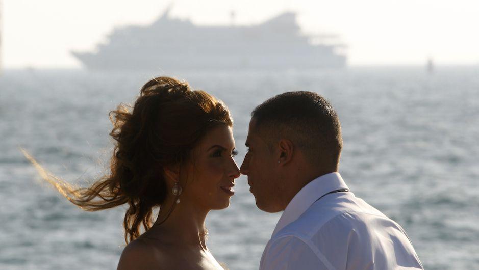 A bride and groom pose for their wedding photographer as Mavi Marmara is escorted to Ashdod port