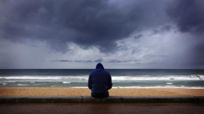 man looking at stormy weather