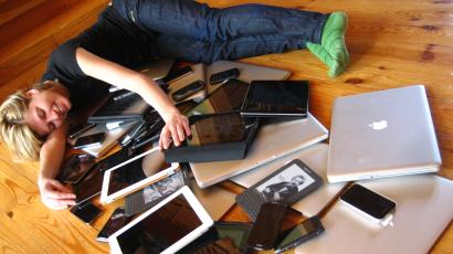 laptops and mobile devices on the floor.