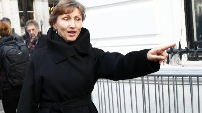 Marina Litvinenko, widow of murdered KGB agent Alexander Litvinenko gestures as she makes her way back to the High Court in central London, January 27, 2015.