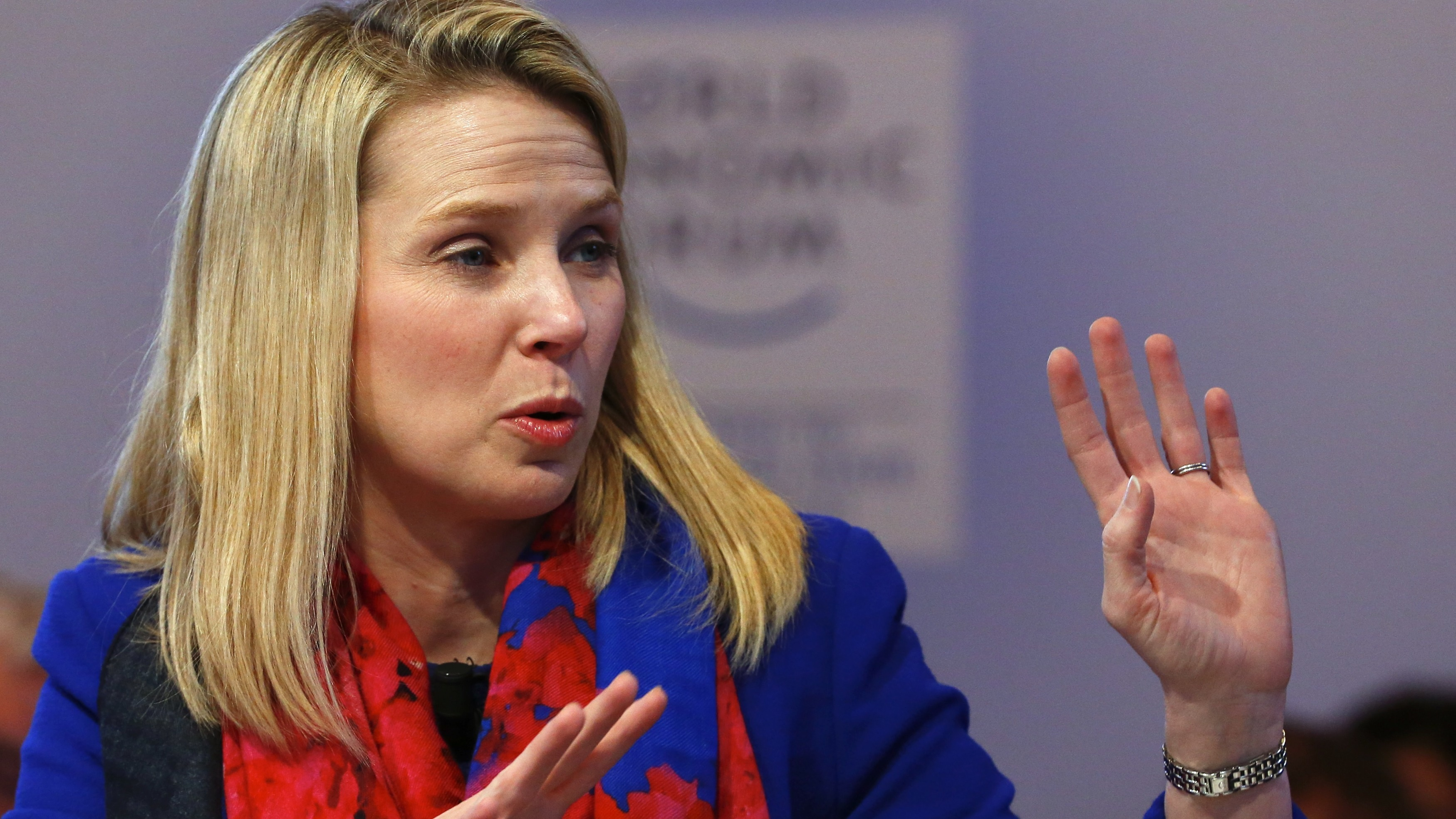 "Yahoo CEO Marissa Mayer gestures before the session ""In Tech We Trust"" in the Swiss mountain resort of Davos January 22, 2015. More than 1,500 business leaders and 40 heads of state or government attend the Jan. 21-24 meeting of the World Economic Forum (WEF) to network and discuss big themes, from the price of oil to the future of the Internet. This year they are meeting in the midst of upheaval, with security forces on heightened alert after attacks in Paris, the European Central Bank considering a radical government bond-buying programme and the safe-haven Swiss franc rocketing. REUTERS/Ruben Sprich"