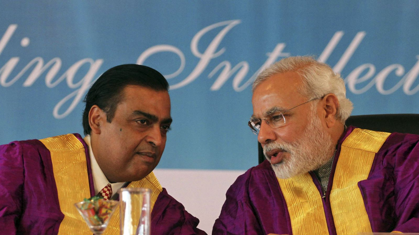 Gujarat state Chief Minister Narendra Modi, right, speaks with Chairman and Managing Director of Reliance Industries Limited Mukesh Ambani during the convocation ceremony of Pandit Deendayal Petroleum University (PDPU) in Gandhinagar, in the western Indian state of Gujarat, Saturday, Oct. 19, 2013. Modi is India's main opposition Bharatiya Janata Party's candidate for prime minister if it wins national elections next year.