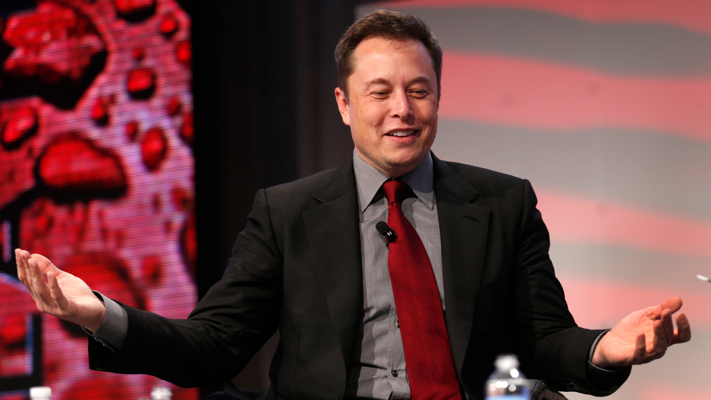 """Tesla Motors CEO Elon Musk talks at the Automotive World News Congress at the Renaissance Center in Detroit, Michigan, January 13, 2015. Tesla Motors Inc plans to boost production of electric cars to """"at least a few million a year"""" by 2025 from fewer than 40,000 last year, Musk said Tuesday. Picture taken January 13, 2015."""