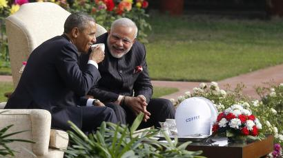 U.S. President Barack Obama and India's Prime Minister Narendra Modi (R) talk as they have coffee and tea together in the gardens of Hyderabad House in New Delhi January 25, 2015. Obama is visiting India for three days to attend Republic Day celebrations and meet with Indian leaders. bespoke, suit