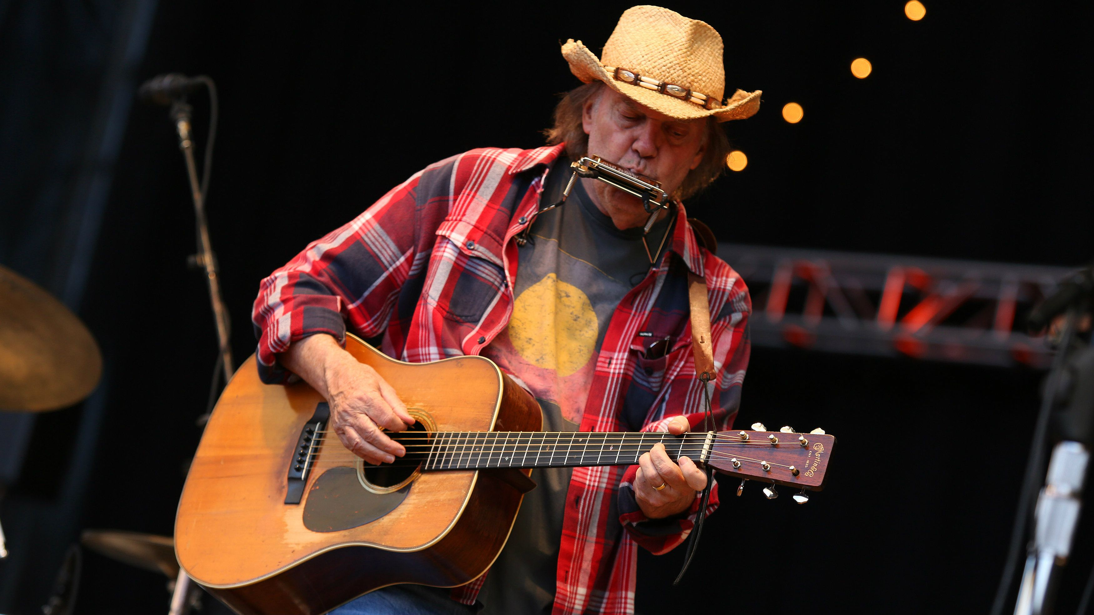 Neil Young playing music live.