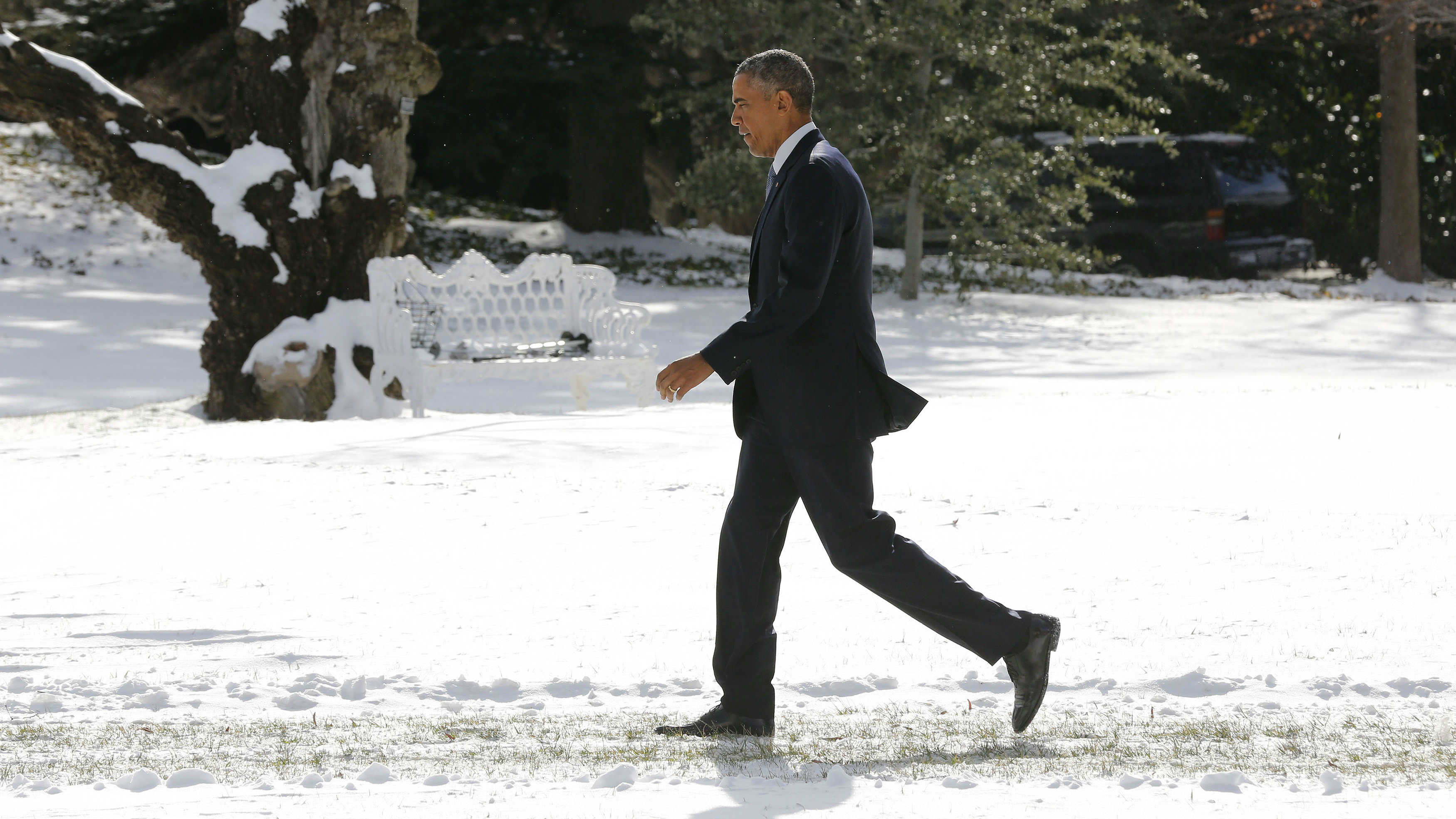 President Barack Obama walks in the snow on the South Lawn of the White House in Washington, January 7, 2015.