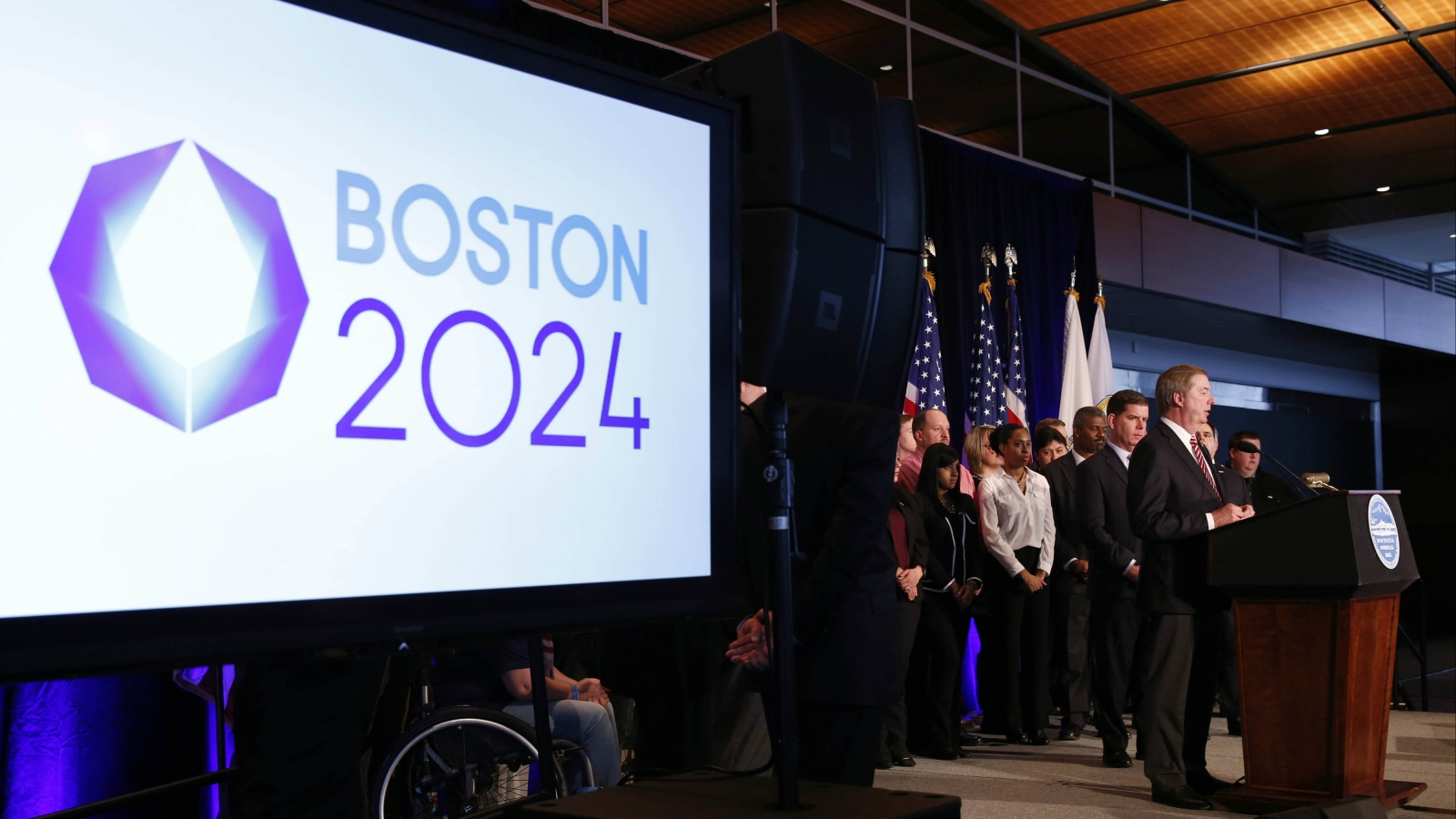 United States Olympic Committee president Lawrence F. Probst III , flanked by Boston mayor Martin J. Walsh (left) , talks about the USOC selecting Boston as its applicant city to host the 2024 Olympic and Paralympic Games during a press conference at the Boston Convention Center and Exhibition Center.