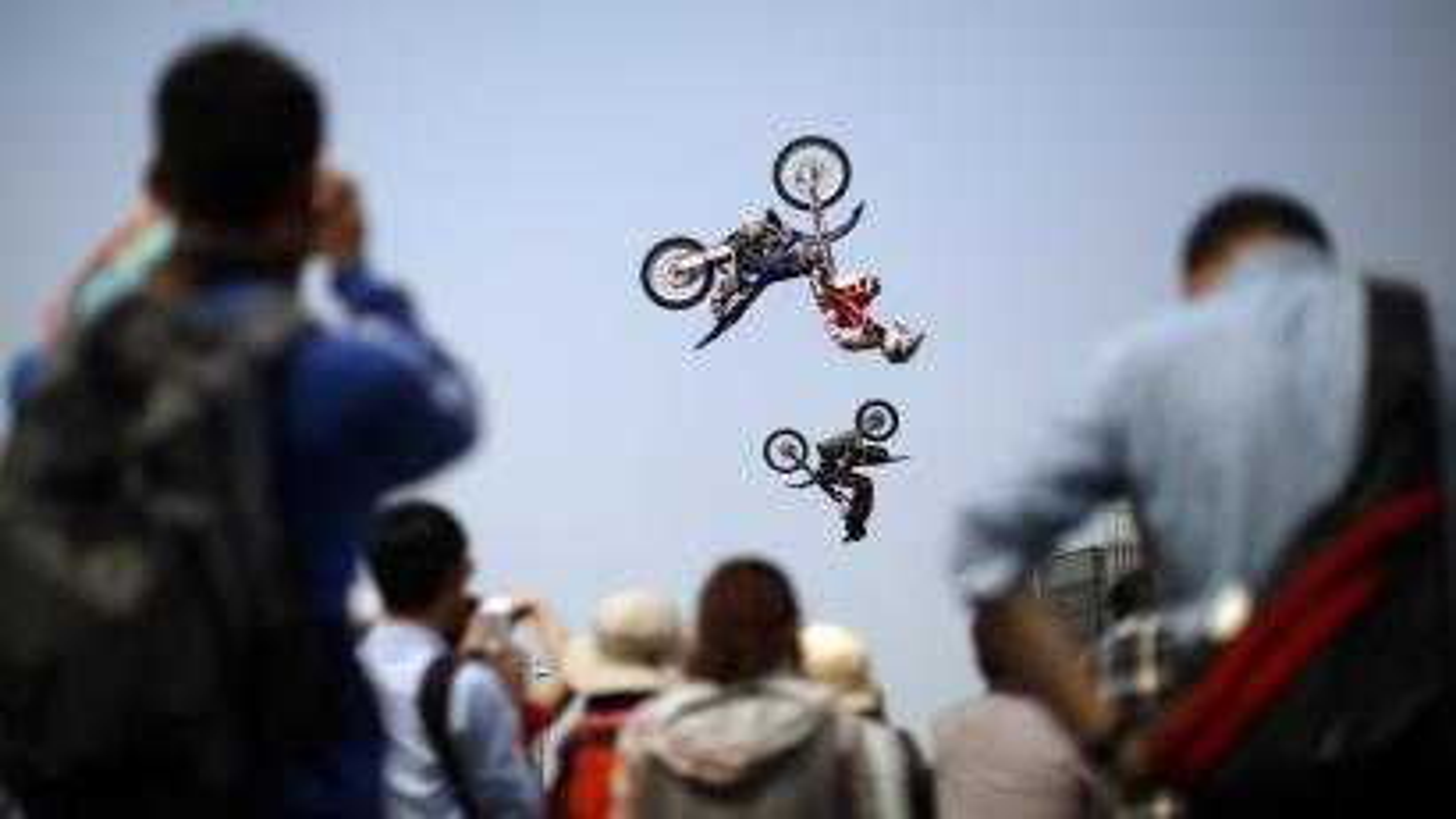people doing bike tricks