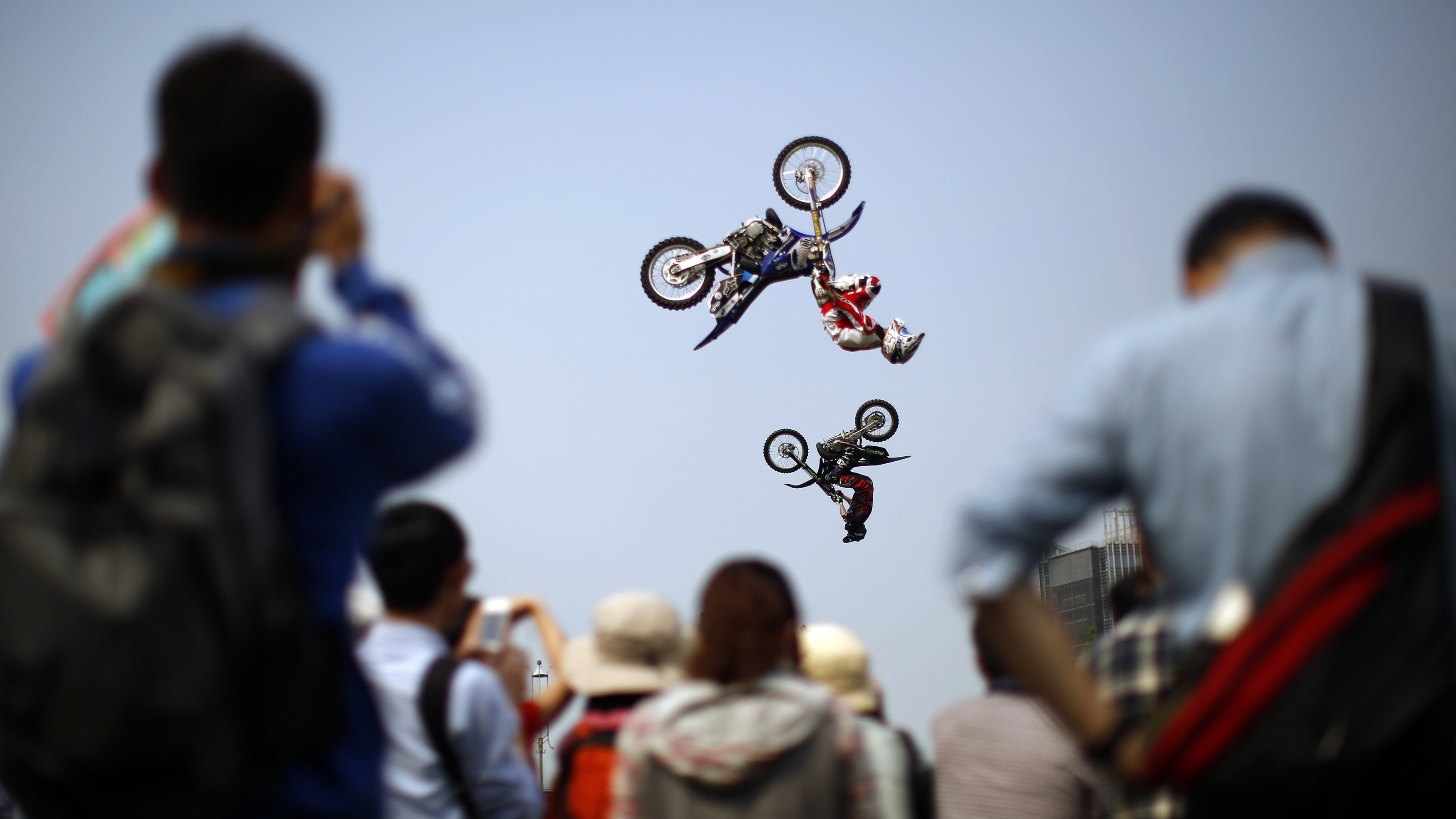Competitors perform at the FMX Course competition during the World Extreme Games in Shanghai April 30, 2014. The games will be held in Shanghai until to May 3.