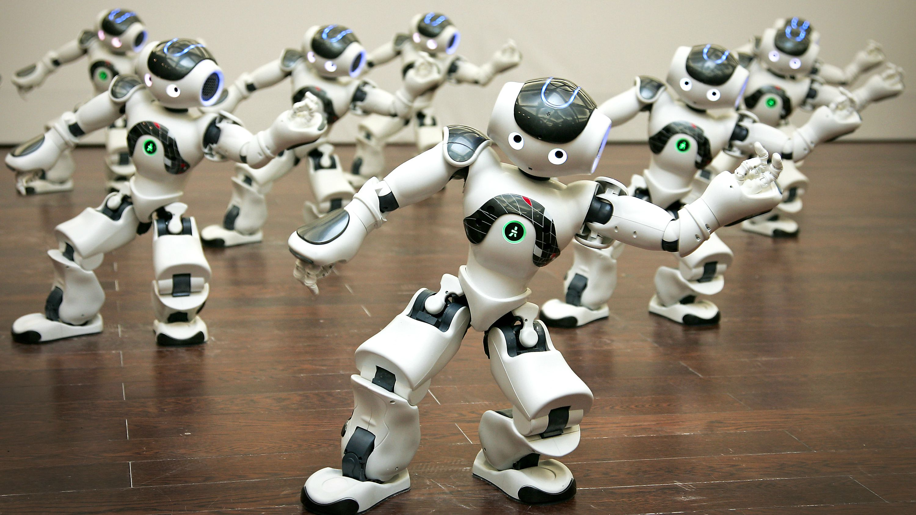 A group of programmable humanoid Nao robots, developed by a French company Aldebaran Robotics, perform dance inside the France Pavilion at the Shanghai Expo in Shanghai, China Friday, June 18, 2010. (AP Photo)