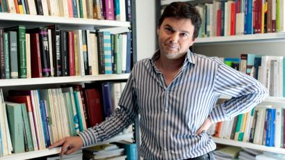 Thomas Piketty, French economist behind Socialist party candidate Francois Hollande's plan to tax all income over one million euros ($1.3 million) per year at 75 percent, poses in his office in Paris April 11, 2012. At 40, Piketty is one of France's top economists and has won international acclaim for his pioneering work about income inequality worldwide. Picture taken April 11, 2012.