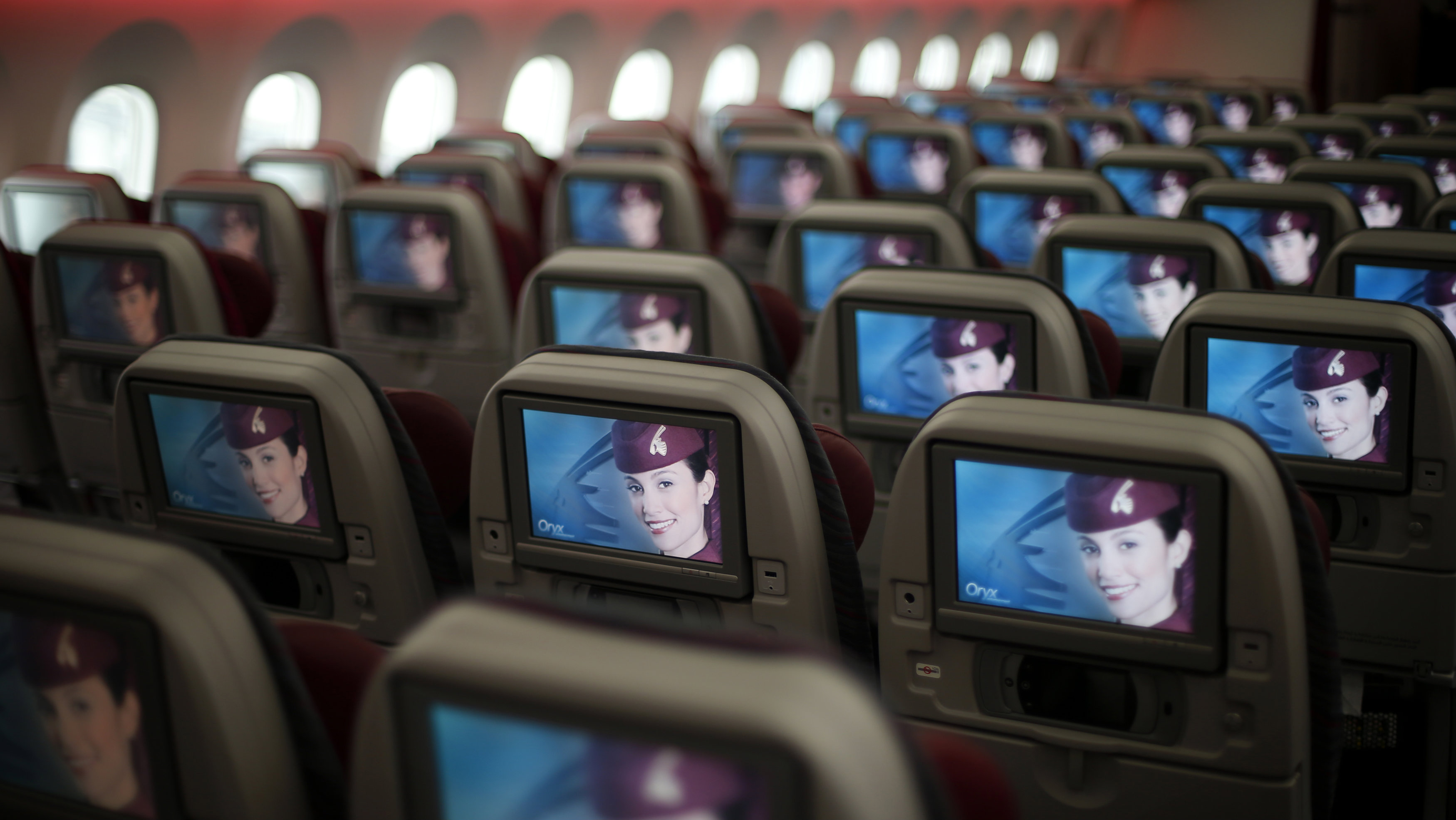 Seats and screens are seen in the economy class cabin of Qatar Airways new Boeing 787 Dreamliner are seen after it arrived on it's inaugural flight to Heathrow Airport, west London December 13, 2012. Qatar Airways is the first airline to operate scheduled Dreamliner flights to and from the UK.