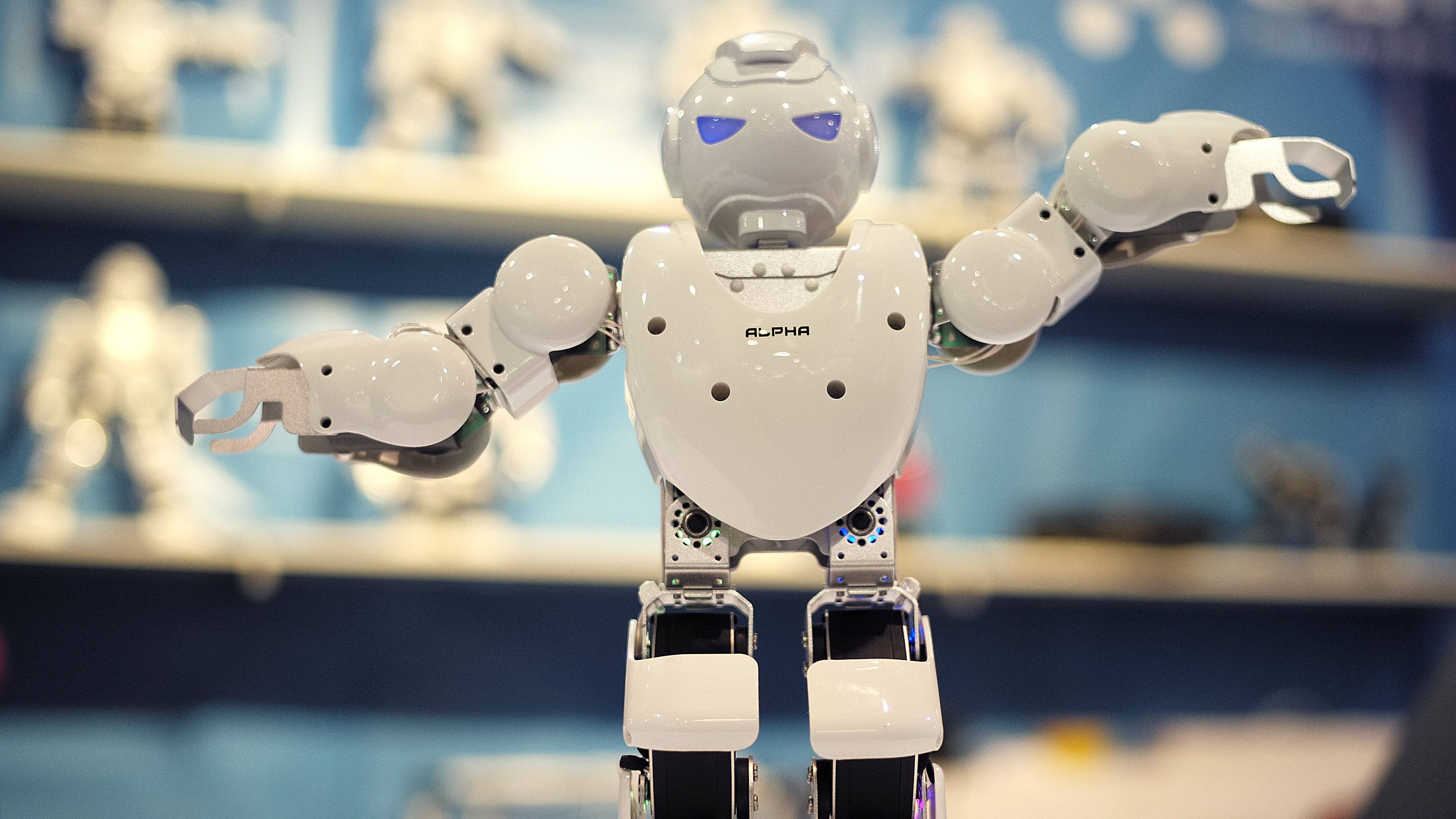 A toy robot named Alpha dances to a music at the Ubtech booth at the International CES Thursday, Jan. 8, 2015, in Las Vegas. (AP Photo/Jae C. Hong)