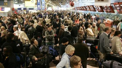 Passengers queue in Terminal 4 at Heathrow airport in west London.