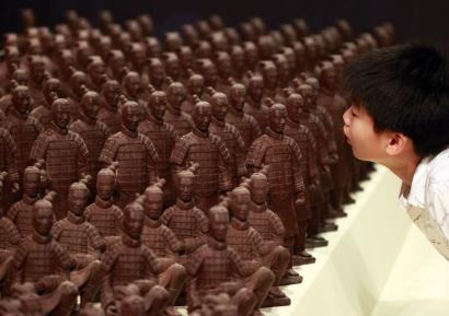 A boy looks at chocolate Terracotta Warriors displayed at the World Chocolate Wonderland in Taipei.
