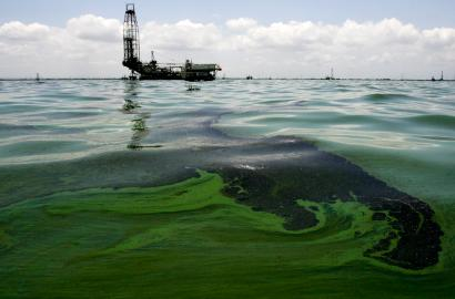 Oil spill on water is seen near an oil production facility at Maracaibo lake near the coastal town of Barranquitas August 15, 2011.