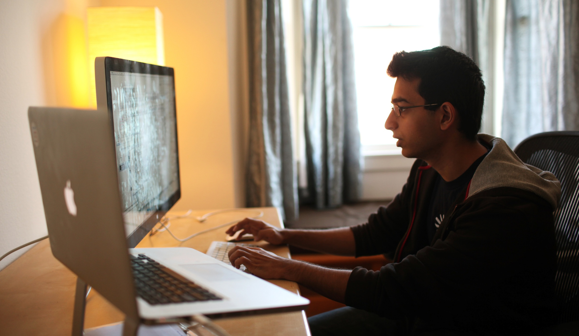 Sahil Lavingia, 19, chief executive officer (CEO) of Gumroad, an online payments company he started, works in his home which doubles as his office in the SOMA neighborhood of San Francisco February 17, 2012. Lavingia, who was born in New York and grew up in places like London, Hong Kong and Singapore, dropped out of the University of Southern California to work at online bulletin board company Pinterest. He also developed the Turntable.fm app for the iPhone. Picture taken February 17, 2012. To match Feature VENTURE/YOUNG   REUTERS/Robert Galbraith (UNITED STATES - Tags: SCIENCE TECHNOLOGY BUSINESS) - RTR2Y6KM