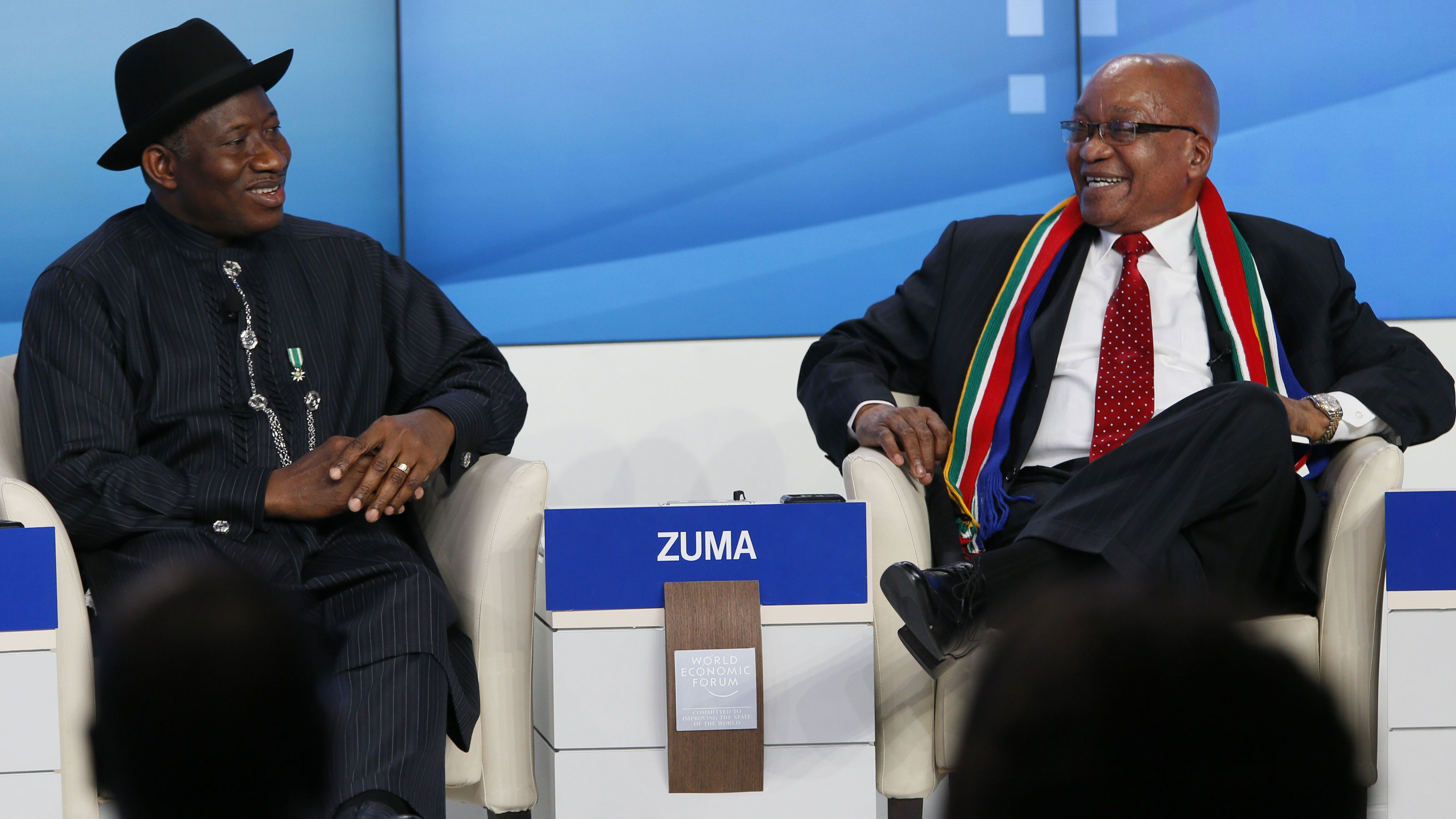 Nigeria's President Goodluck Ebele Jonathan (L) and South Africa's President Jacob Zuma attend the annual meeting of the World Economic Forum (WEF) in Davos January 23, 2013. REUTERS/Pascal Lauener (SWITZERLAND - Tags: POLITICS BUSINESS)