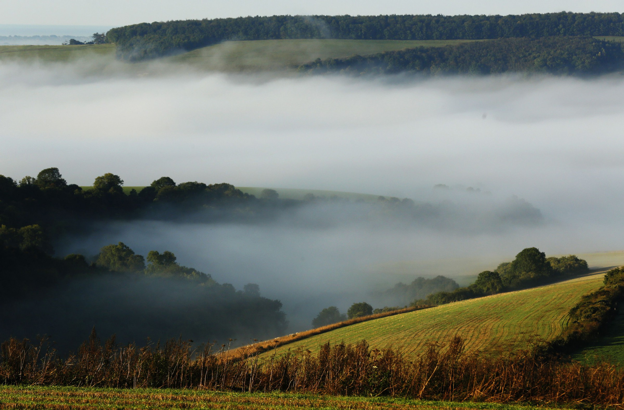 Autumn mists hang over villages and the countryside in the South Downs National Park near Amberley in Southern England October 7, 2013.