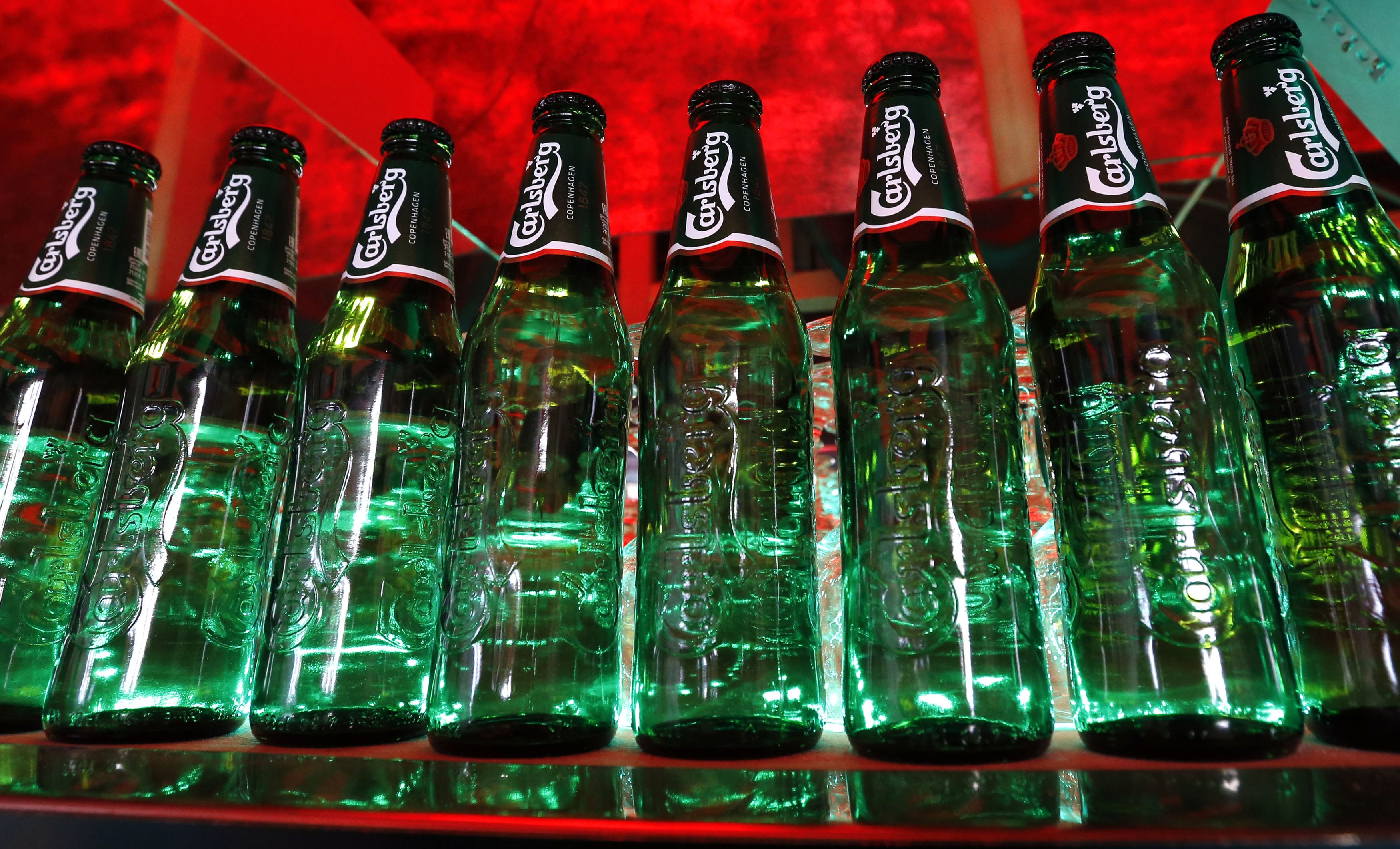 Bottles of Carlsberg beer are seen in a bar in St. Petersburg June 17, 2014. Denmark's Carlsberg will keep its breweries in Russia running regardless of empty capacity, despite other brewers closing plants as Western sanctions over Ukraine hamper an already faltering economy.