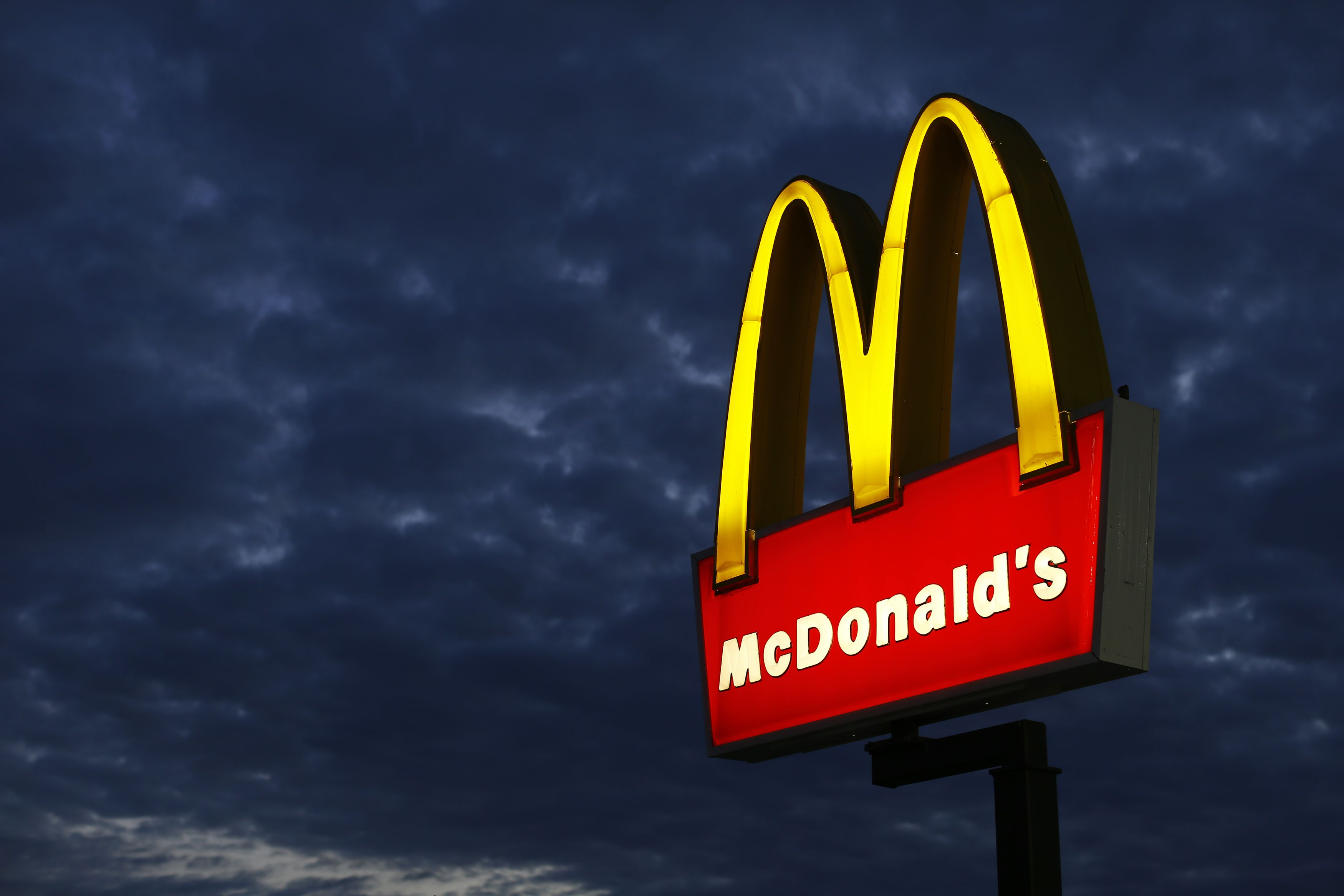A McDonald's restaurant is pictured in Encinitas, California September 9, 2014. McDonald's Corp on Tuesday reported declining sales at established restaurants across all regions in August, the fifth monthly drop since CEO Don Thompson took the helm in July 2012, and warned a China supplier scandal would cut into profits.  REUTERS/Mike Blake (UNITED STATES - Tags: BUSINESS FOOD) - RTR45JJI