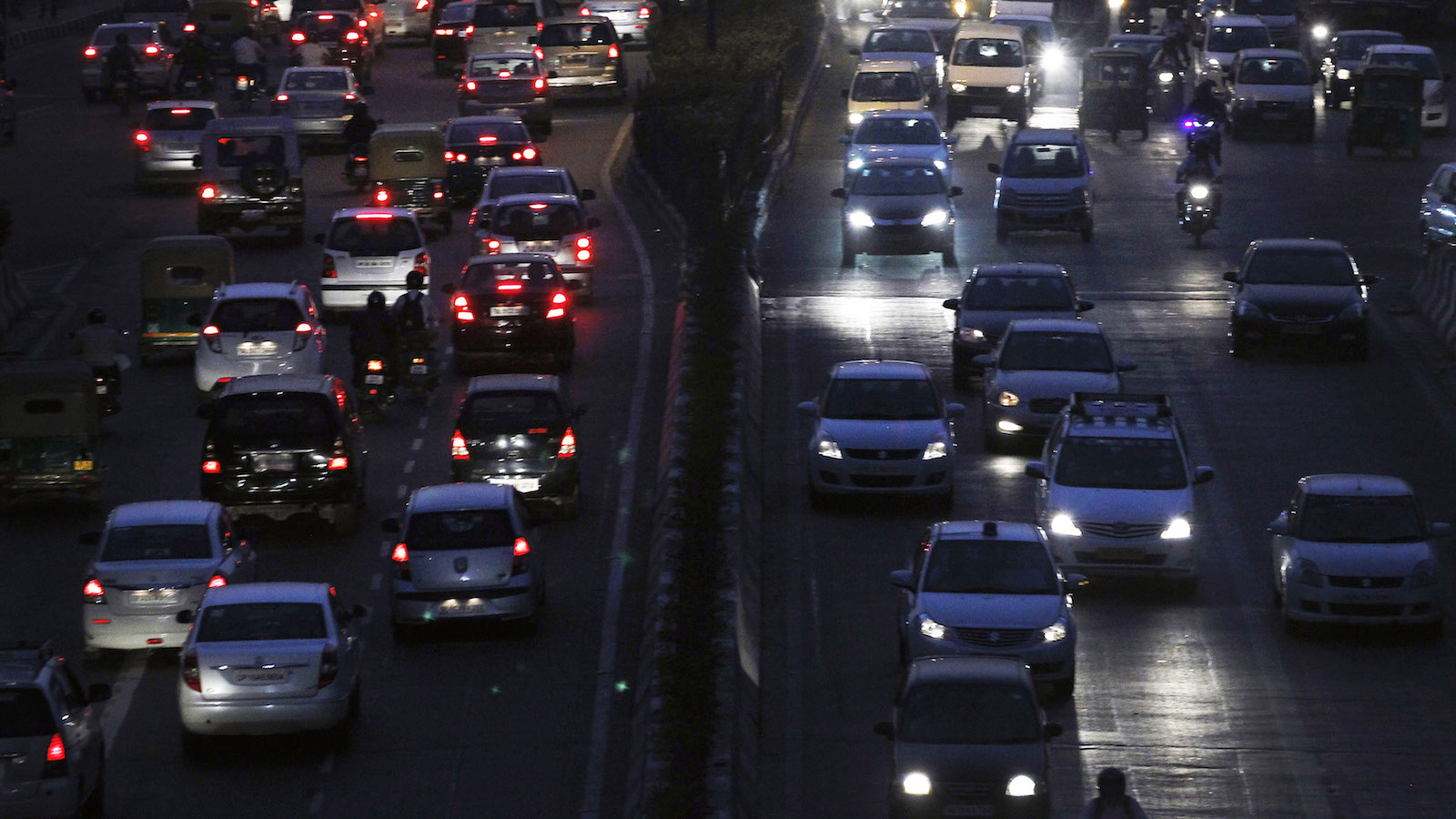 Heavy traffic moves along a busy road during the evening in New Delhi October 20, 2014