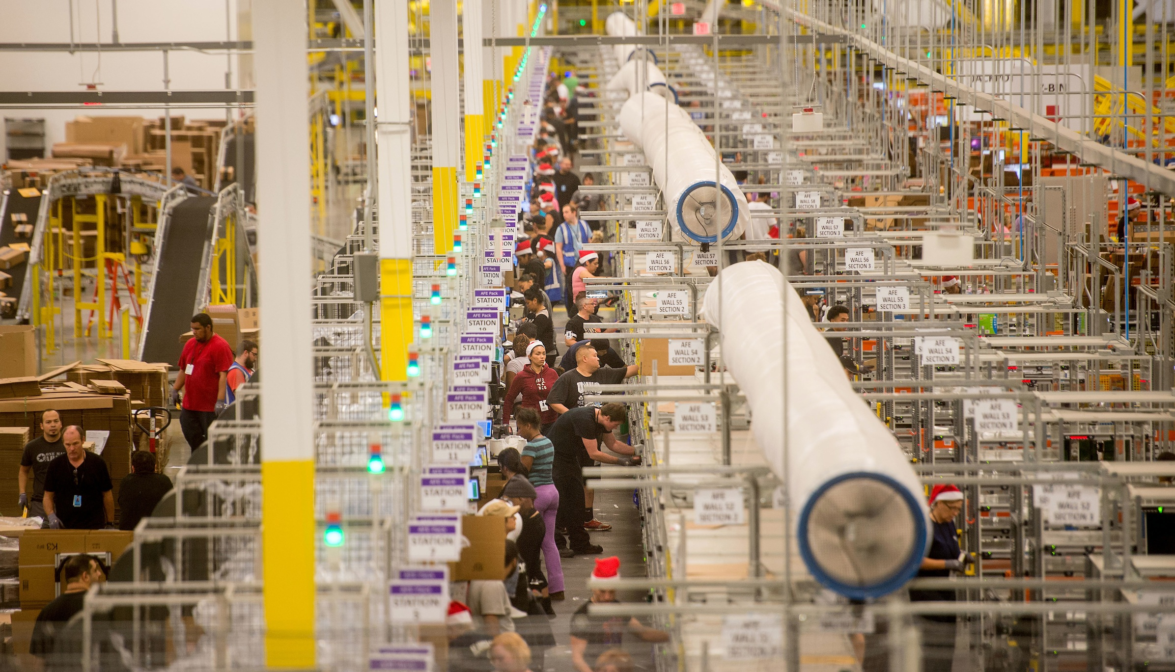 Workers prepare outgoing shipments at an Amazon Fulfillment Center, ahead of the Christmas rush, in Tracy, California, November 30, 2014. REUTERS/Noah Berger  (UNITED STATES - Tags: BUSINESS SOCIETY TPX IMAGES OF THE DAY) - RTR4G75T