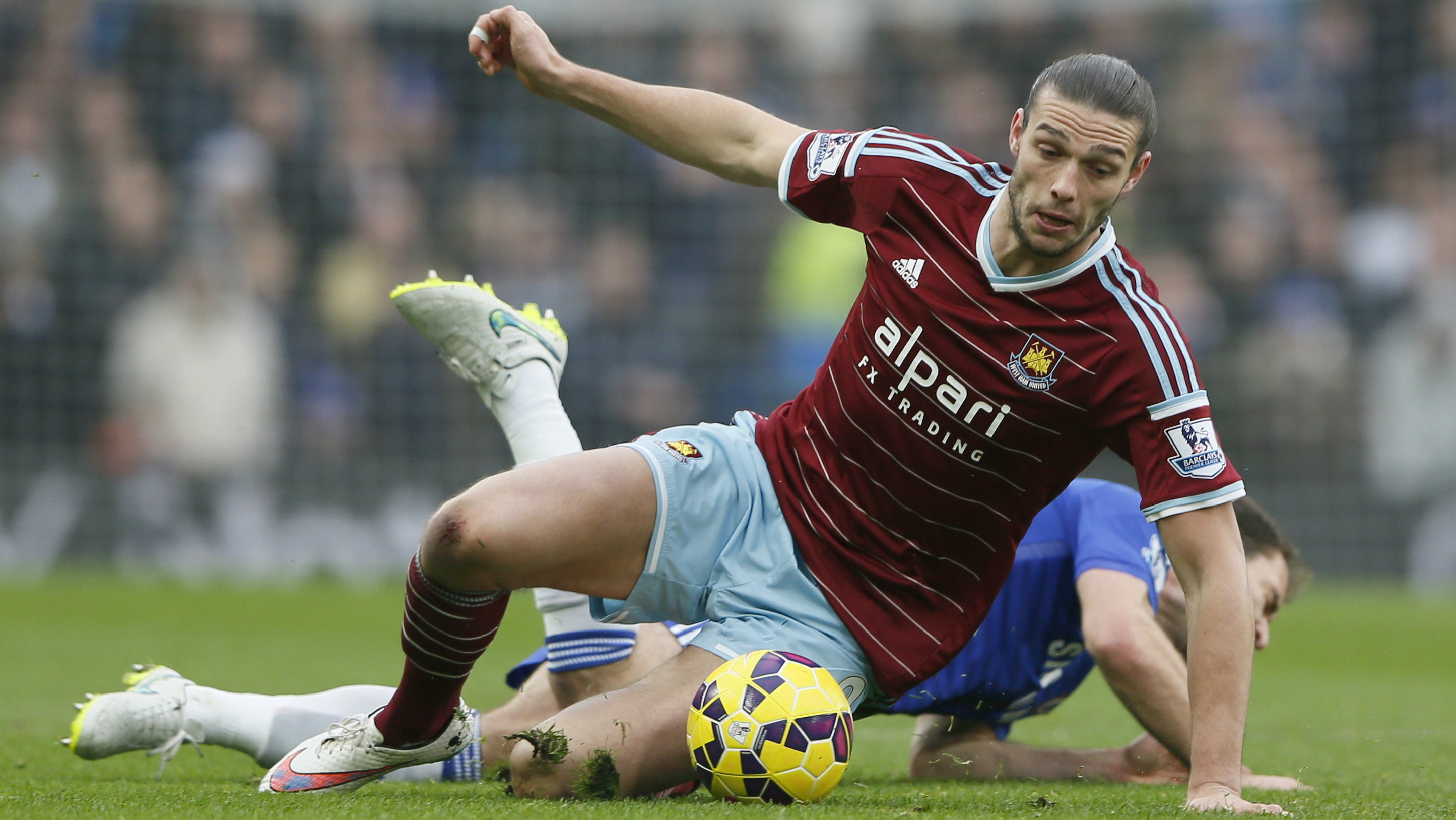 Chelsea's Branislav Ivanovic  is challenged by West Ham United's Andy Carroll during their English Premier League soccer match at Stamford Bridge in London, December 26, 2014.
