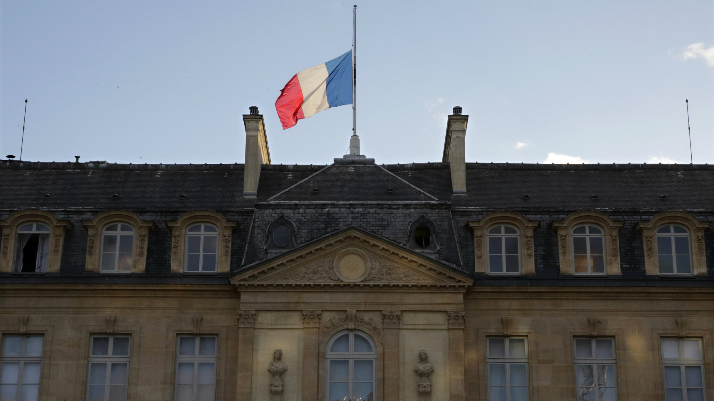 The French flag flies at half-mast above the Elysee Palace in a sign of mourning in Paris January 8, 2015 the day after a shooting at the Paris offices of weekly satirical newspaper Charlie Hebdo.