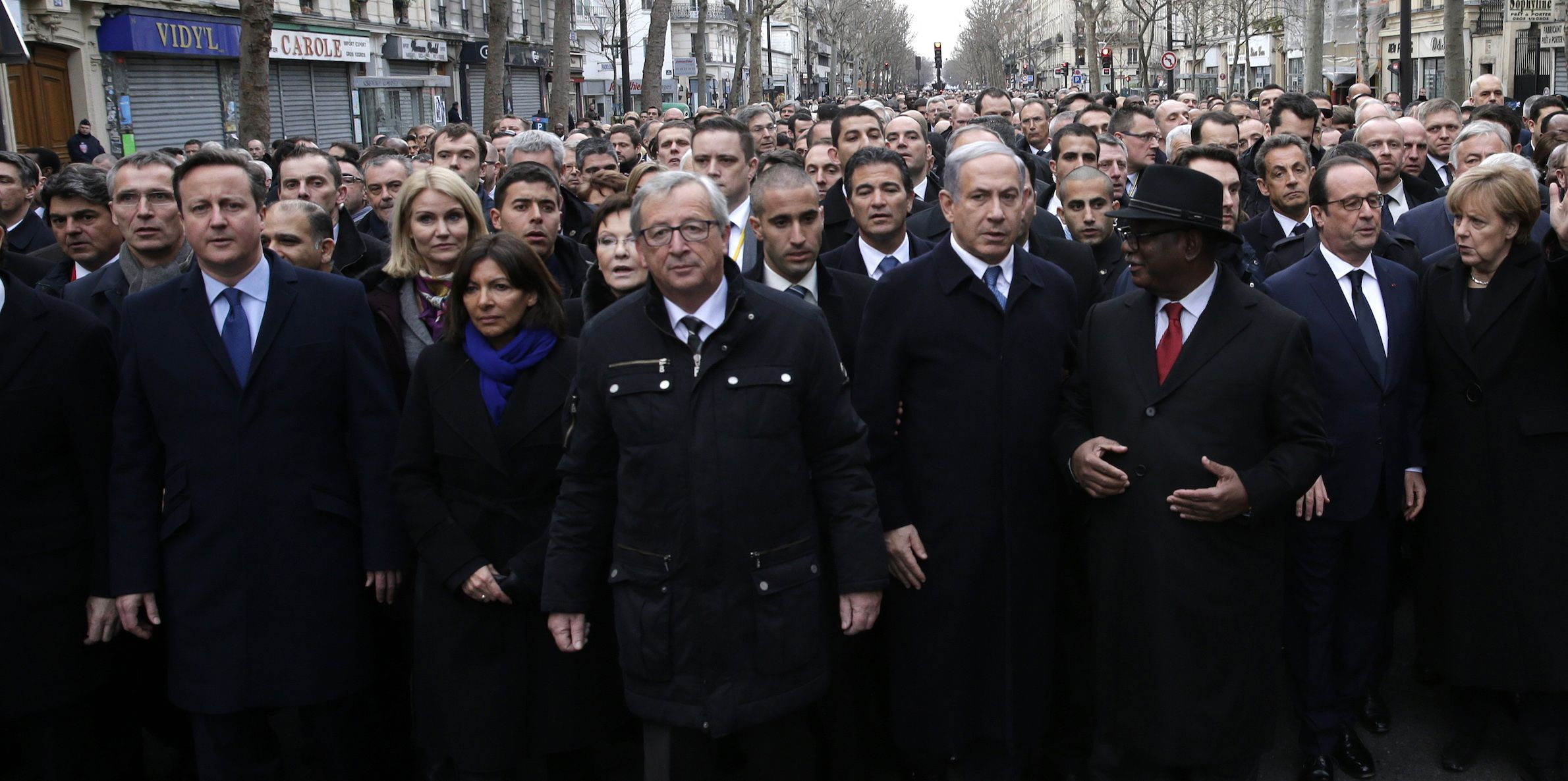 French President Francois Hollande is surrounded by heads of state including Britain's Prime Minister David Cameron (L), Israel's Prime Minister Benjamin Netanyahu (4thR), Mali's President Ibrahim Boubacar Keita (3rdR) and Germany's Chancellor Angela Merkel as they attend the solidarity march (Marche Republicaine) in the streets of Paris January 11, 2015. French citizens will be joined by dozens of foreign leaders, among them Arab and Muslim representatives, in a march on Sunday in an unprecedented tribute to this week's victims following the shootings by gunmen at the offices of the satirical weekly newspaper Charlie Hebdo, the killing of a police woman in Montrouge, and the hostage taking at a kosher supermarket at the Porte de Vincennes.           REUTERS/Philippe Wojazer (FRANCE  - Tags: CRIME LAW POLITICS CIVIL UNREST SOCIETY)   - RTR4KX60