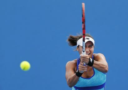 Heather Watson of Britain hits a return to Tsvetana Pironkova of Bulgaria during their women's singles first round match at the Australian Open 2015.