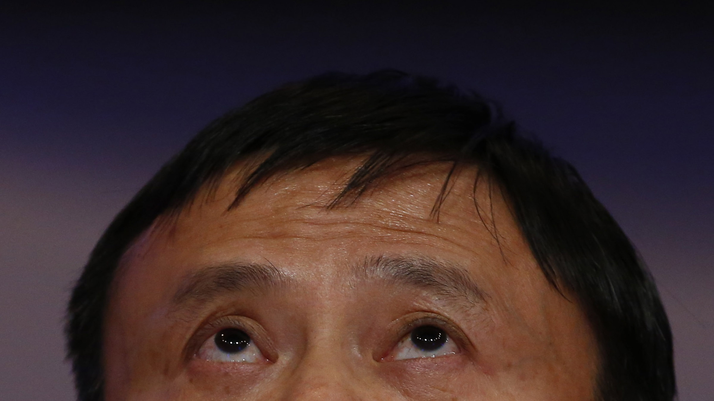 Jack Ma, Founder and Executive Chairman of Alibaba Group, looks up during the session 'An Insight, An Idea with Jack Ma' in the Swiss mountain resort of Davos January 23, 2015. More than 1,500 business leaders and 40 heads of state or government attend the Jan. 21-24 meeting of the World Economic Forum (WEF) to network and discuss big themes, from the price of oil to the future of the Internet. This year they are meeting in the midst of upheaval, with security forces on heightened alert after attacks in Paris, the European Central Bank considering a radical government bond-buying programme and the safe-haven Swiss franc rocketing.          REUTERS/Ruben Sprich (SWITZERLAND  - Tags: BUSINESS HEADSHOT POLITICS)   - RTR4MLE5